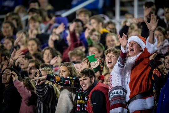 Male's student section cheers during the first half of the 6A regional semifinal high school football game played in Louisville, Kentucky, on Friday, Nov. 23, 2018.