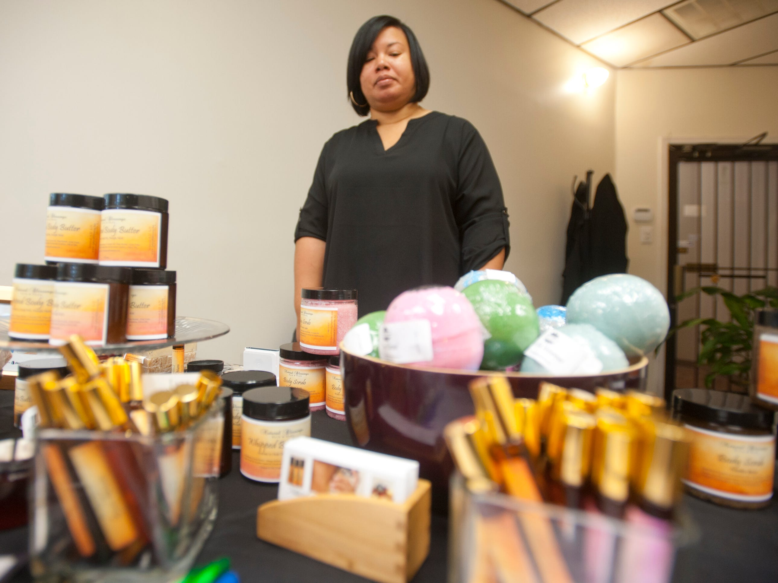Theresa Jones, owner of National Blessings Bath & Body, demonstrates her products at Blue Palm Access, a women's boutique at 2001 W. Broadway, as part of Louisville's Small Business Saturday. 24 November 2018