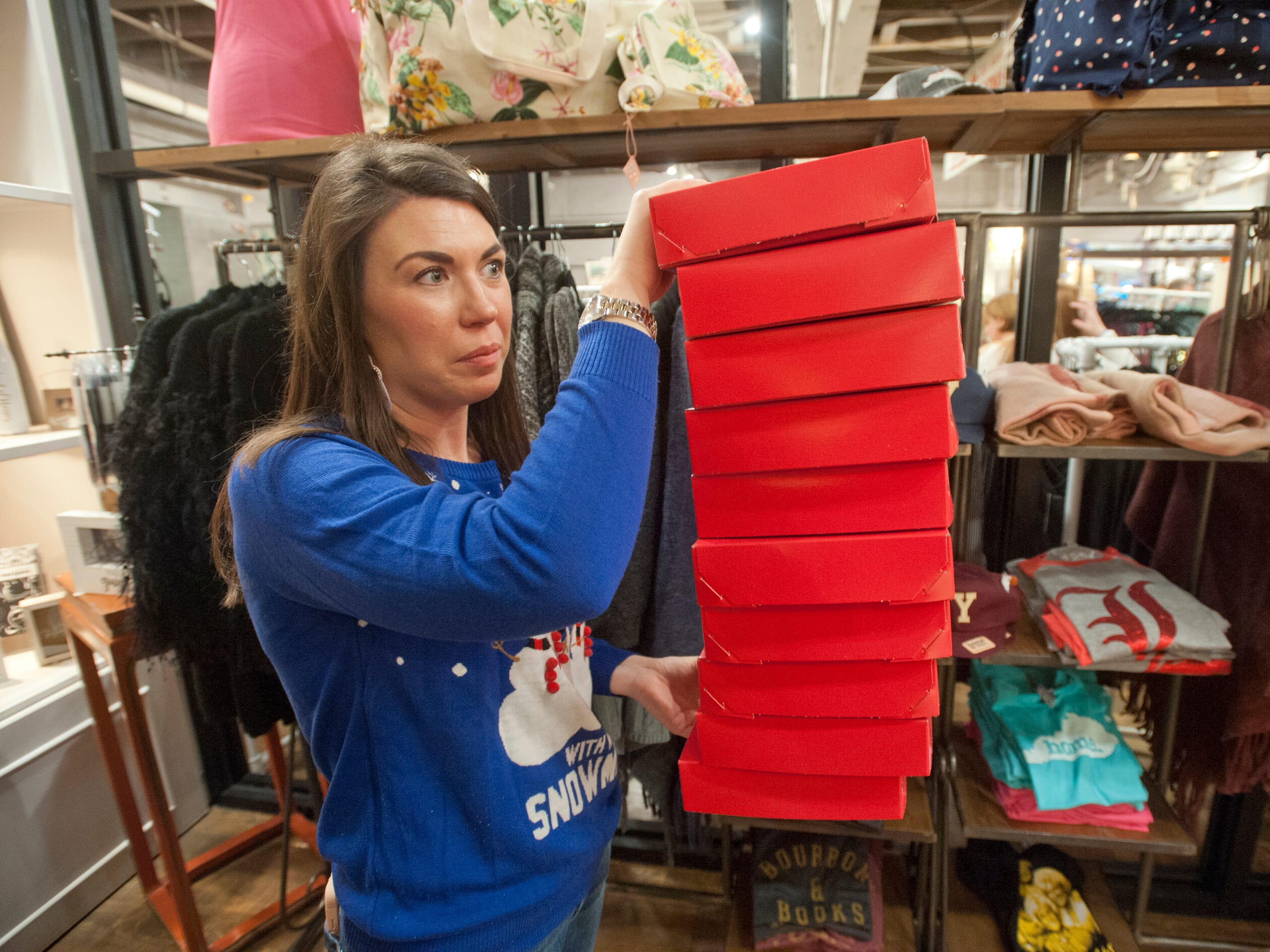 Work The Metal buyer-manager Amanda Peay brings more gift boxes to the register during Small Business Saturday in Louisville. The store is located at 1201 Story Ave. 24 November 2018