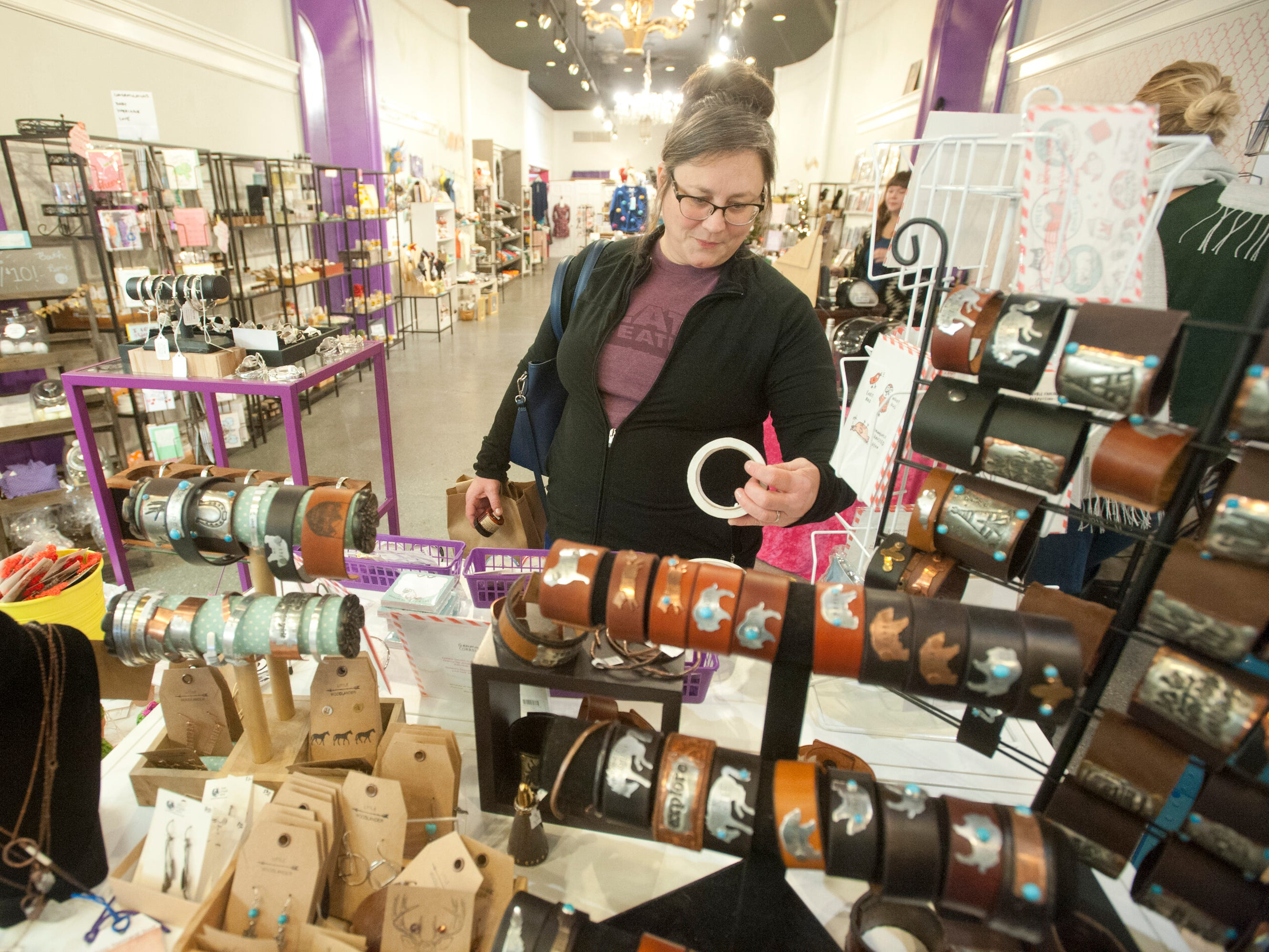 Stephanie Potter of Louisville looks over some of the bracelets at Block Party on south 4th Street during Louisville's Small Business Saturday. 24 November 2018