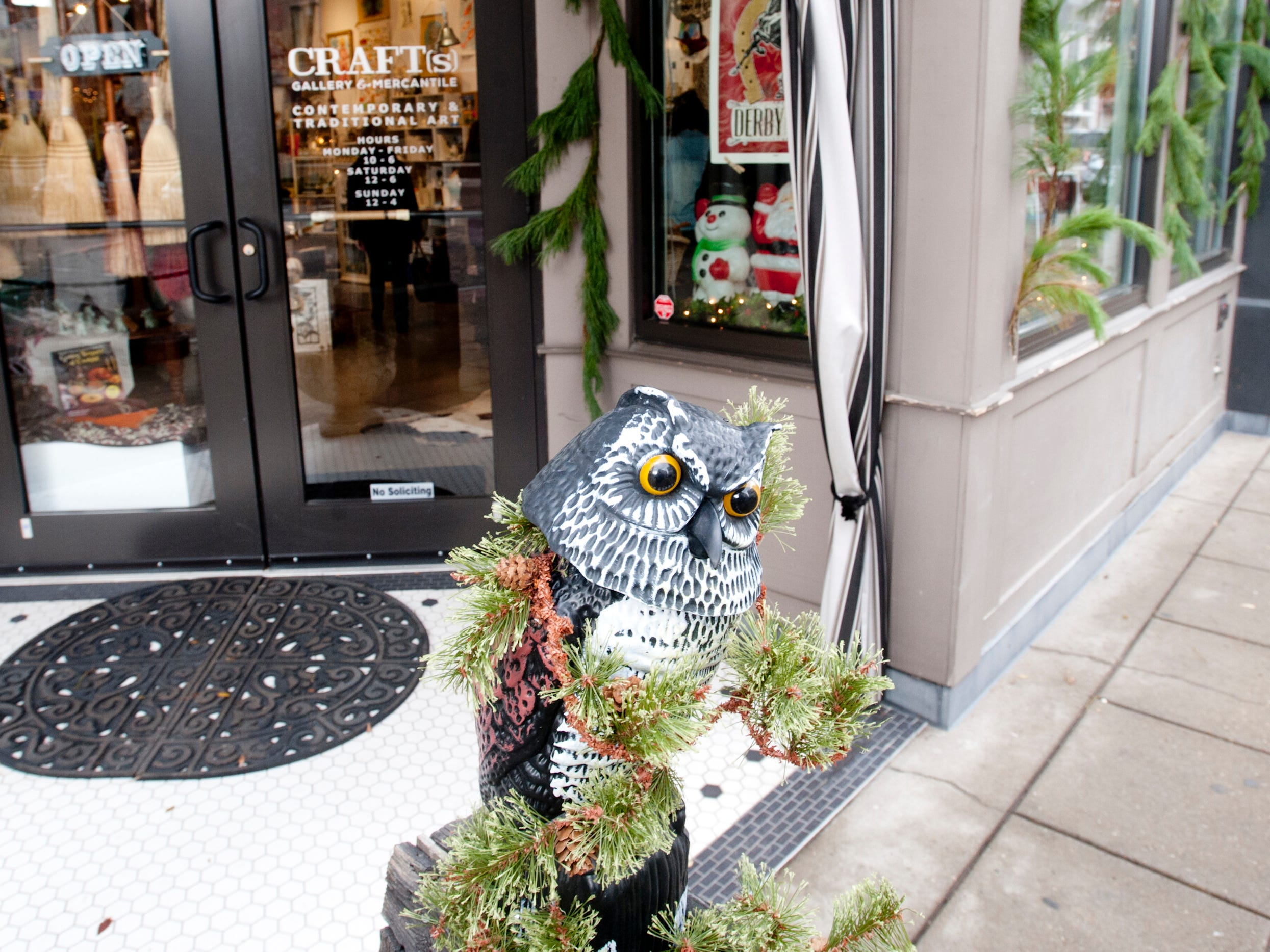 An owl decorated with evergreens, welcomes people the entrance of Craft's Gallery & Mercantile at 574 S. 4th St.24 November 2018