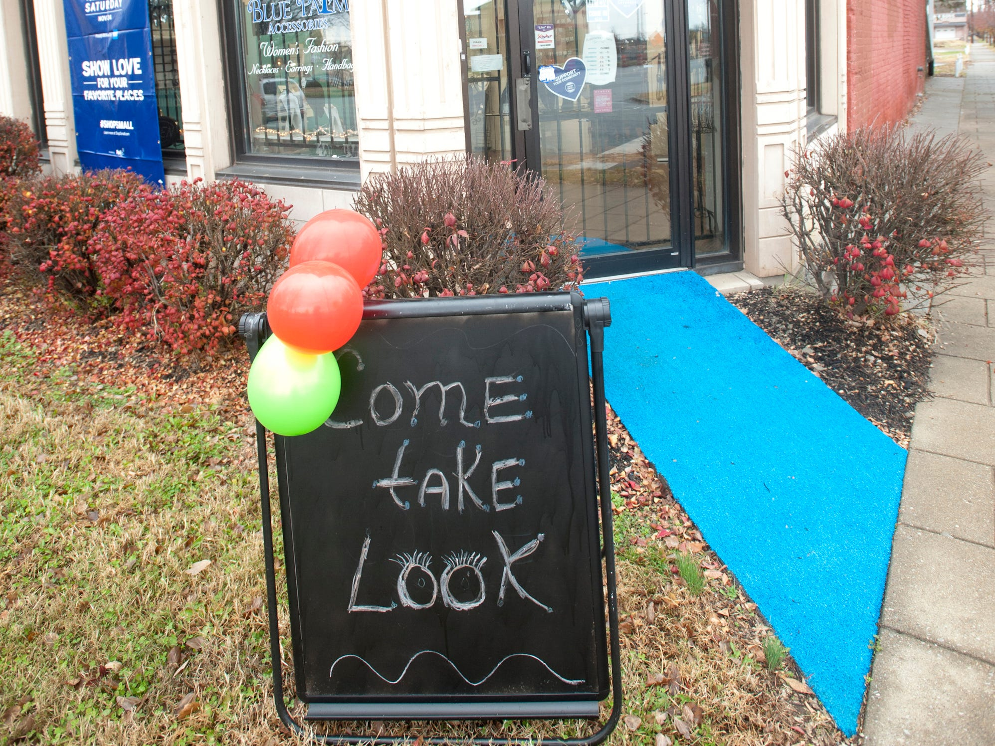 A sign welcomes visitors to Blue Palm Accessories, a women's boutique at 2001 W. Broadway as part of Louisville's Small Business Saturday. 24 November 2018