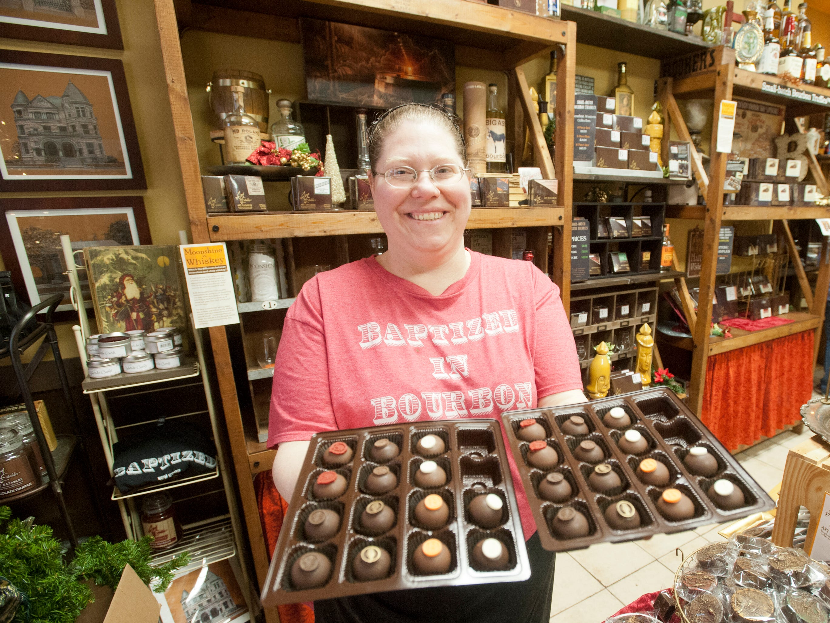 Kelly Ramsey, bourbon-certified chef and owner of Art Edibles, a bourbon chocolate shop at 631 S. 4th Street, displays some of her small-batch bourbon truffles during Louisville's Small Business Saturday. 24 November 2018