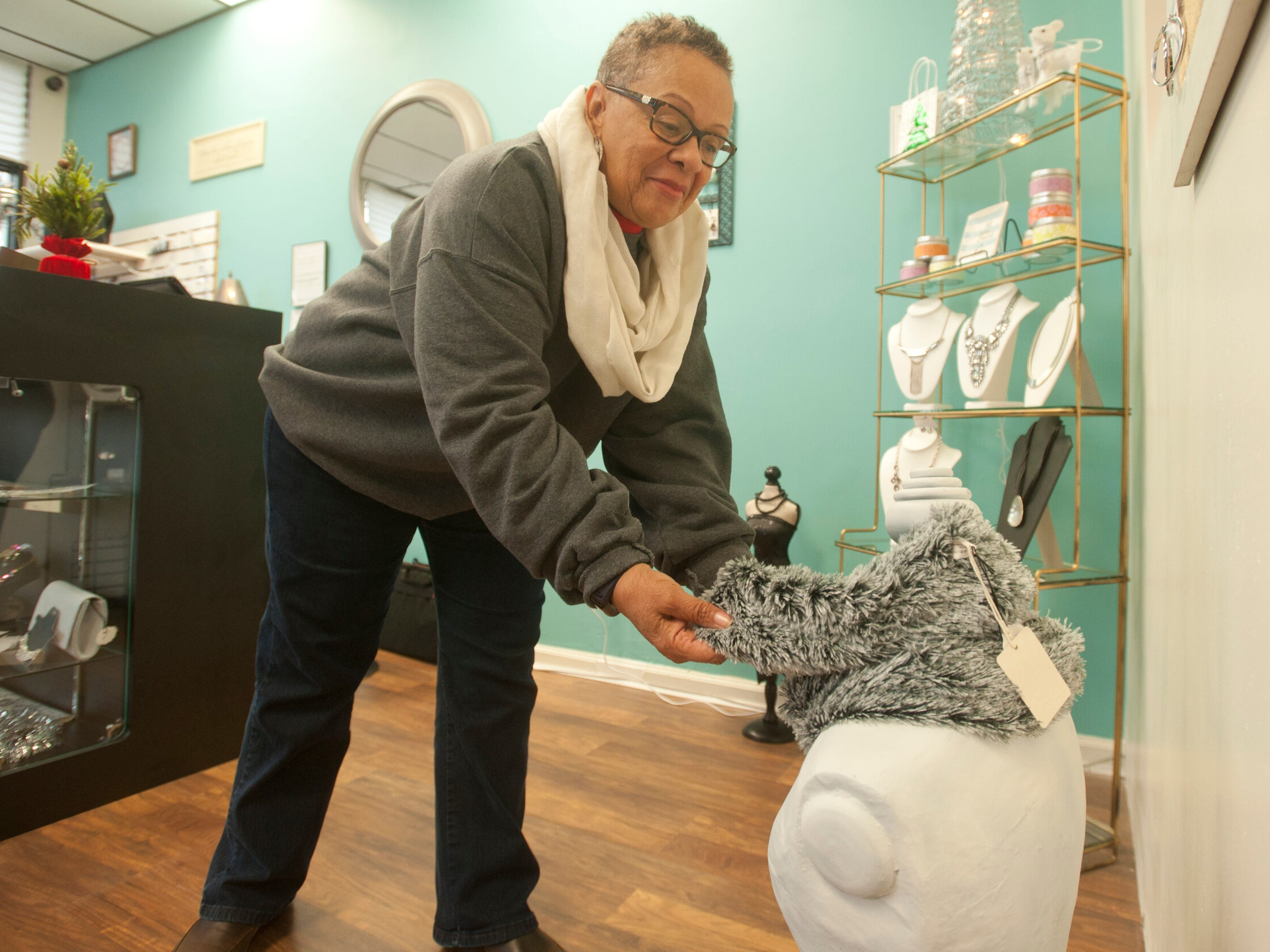 Karen Porter of the Shawnee neighborhood checks out a scarf at Blue Palm Accessories, a women's boutique at 2001 W. Broadway, as part of Louisville's Small Business Saturday. 24 November 2018