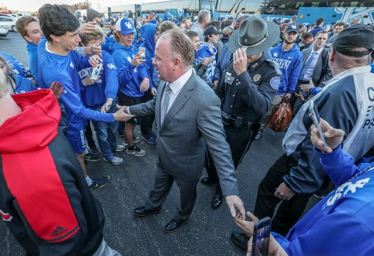 Kentucky coach Mark Stoops arrives at the Cat March into Cardinal Stadium on Saturday afternoon before the game with Louisville. November 24, 2018