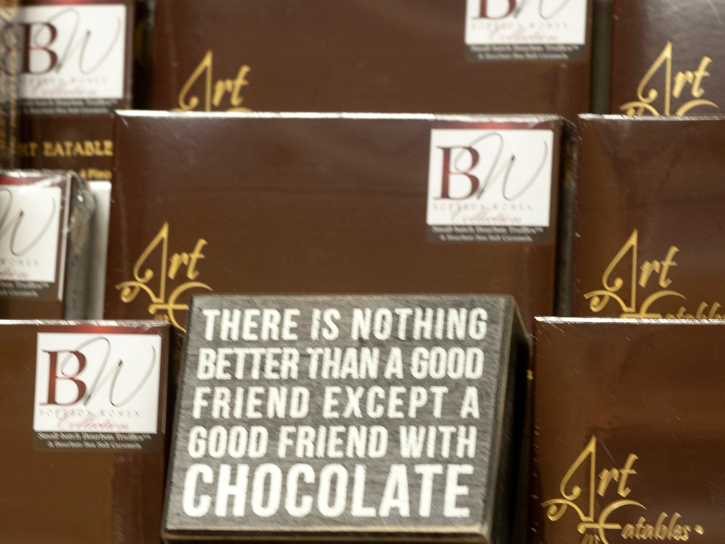Detail of sign among the bourbon chocolate boxes at Art Edibles a bourbon candy store at 631 S. 4th St.24 November 2018