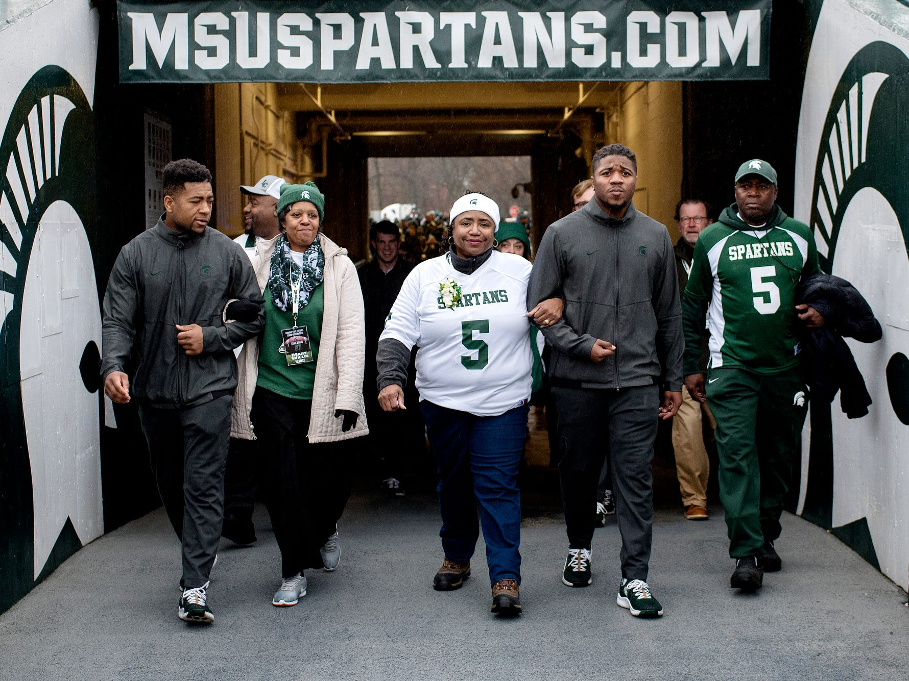Michigan State seniors Khari Willis, left, and Andrew Dowell, right, walks into Spartan Stadium with their family before the game against Rutgers on Saturday, Nov. 24, 2018, in East Lansing.