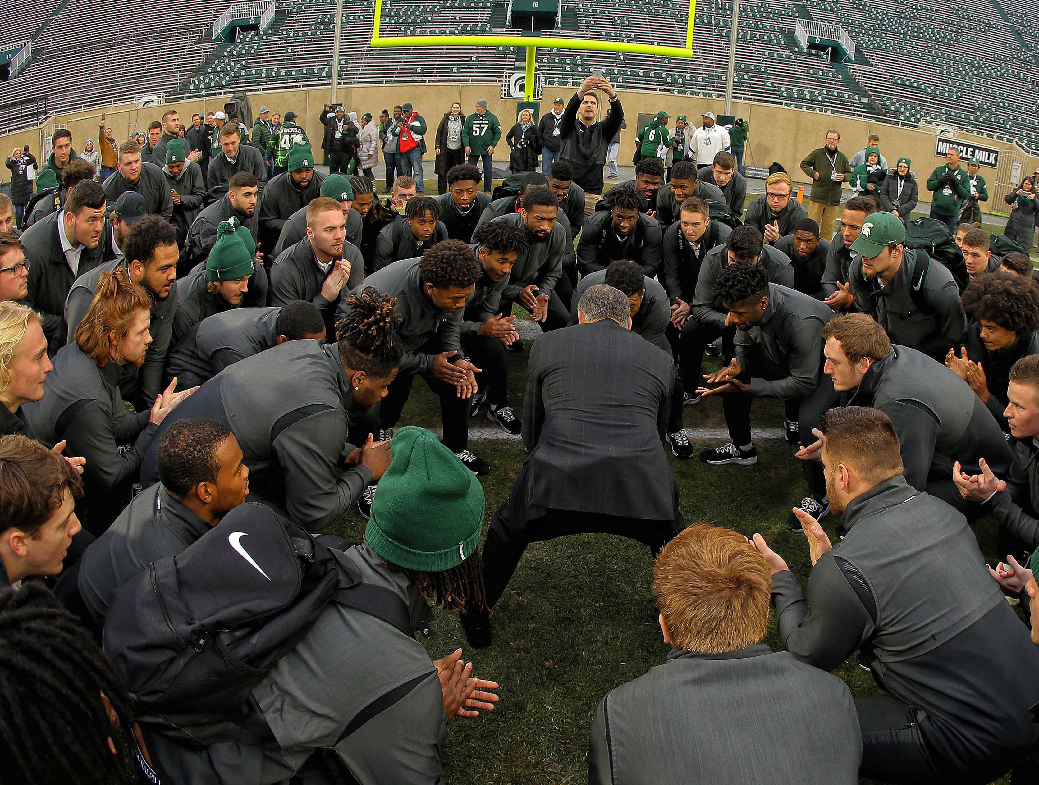 Nov 24, 2018; East Lansing, MI, USA; Michigan State Spartans head coach Mark Dantonio huddles his team in end zone prior to a game against the Rutgers Scarlet Knights at Spartan Stadium. Mandatory Credit: Mike Carter-USA TODAY Sports