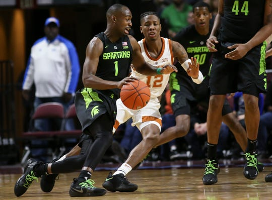 Michigan State's Joshua Langford had a career game in leading the Spartans past Texas on Friday in Las Vegas.