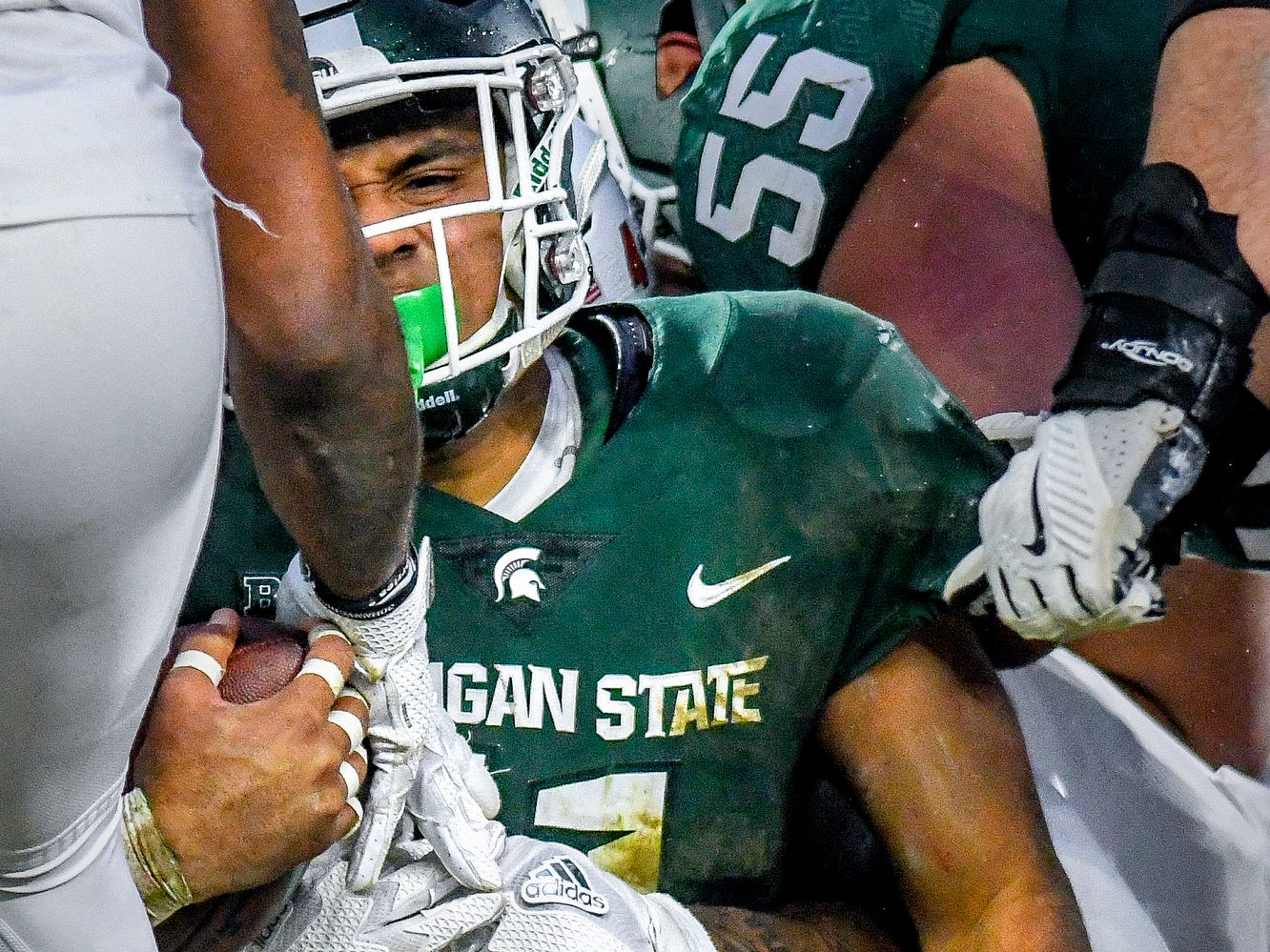 Michigan State's Connor Heyward looks to see if he made a first down at the end of a run during the first quarter on Saturday, Nov. 24, 2018, at Spartan Stadium in East Lansing.