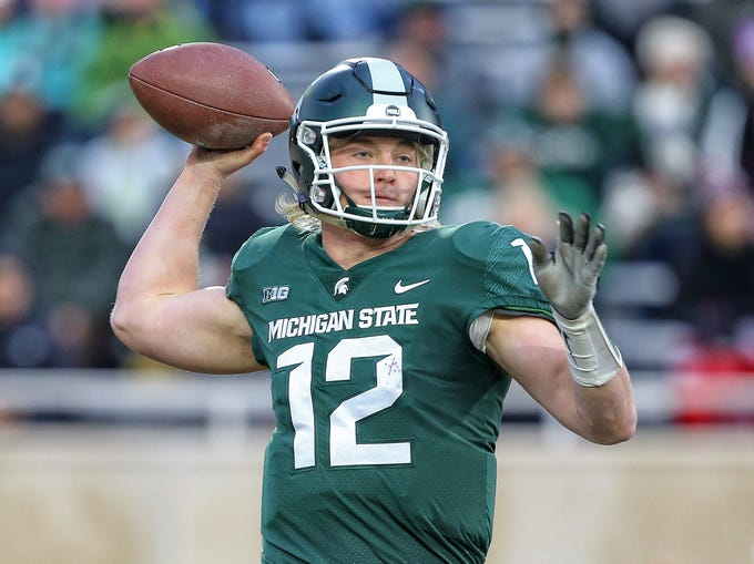Nov 24, 2018; East Lansing, MI, USA; Michigan State Spartans quarterback Rocky Lombardi (12) drops back to throw the ball during the first quarter of a game against the Rutgers Scarlet Knights at Spartan Stadium. Mandatory Credit: Mike Carter-USA TODAY Sports