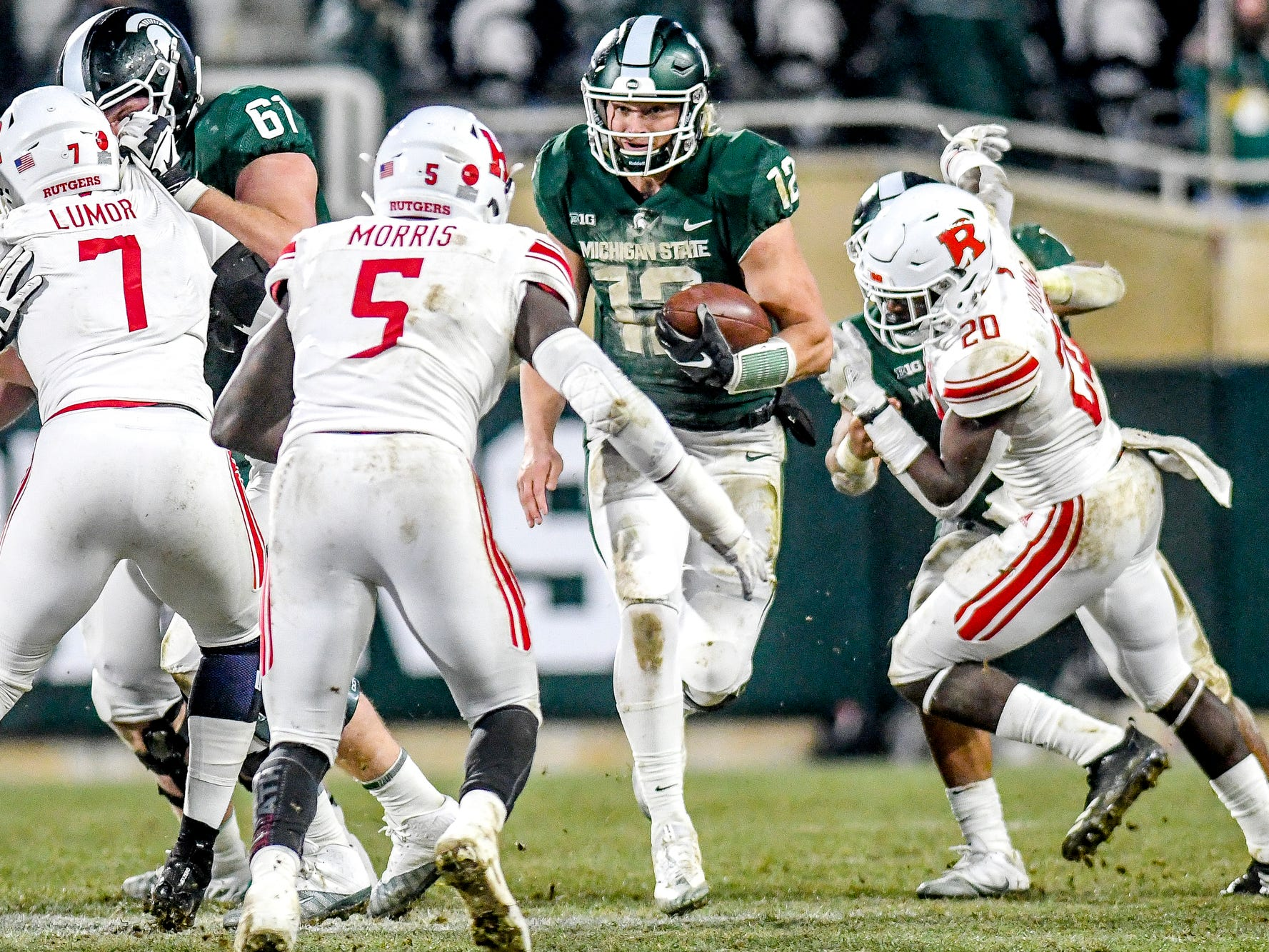 Michigan State's quarterback Rocky Lombardi runs for a gain during the second quarter on Saturday, Nov. 24, 2018, at Spartan Stadium in East Lansing.