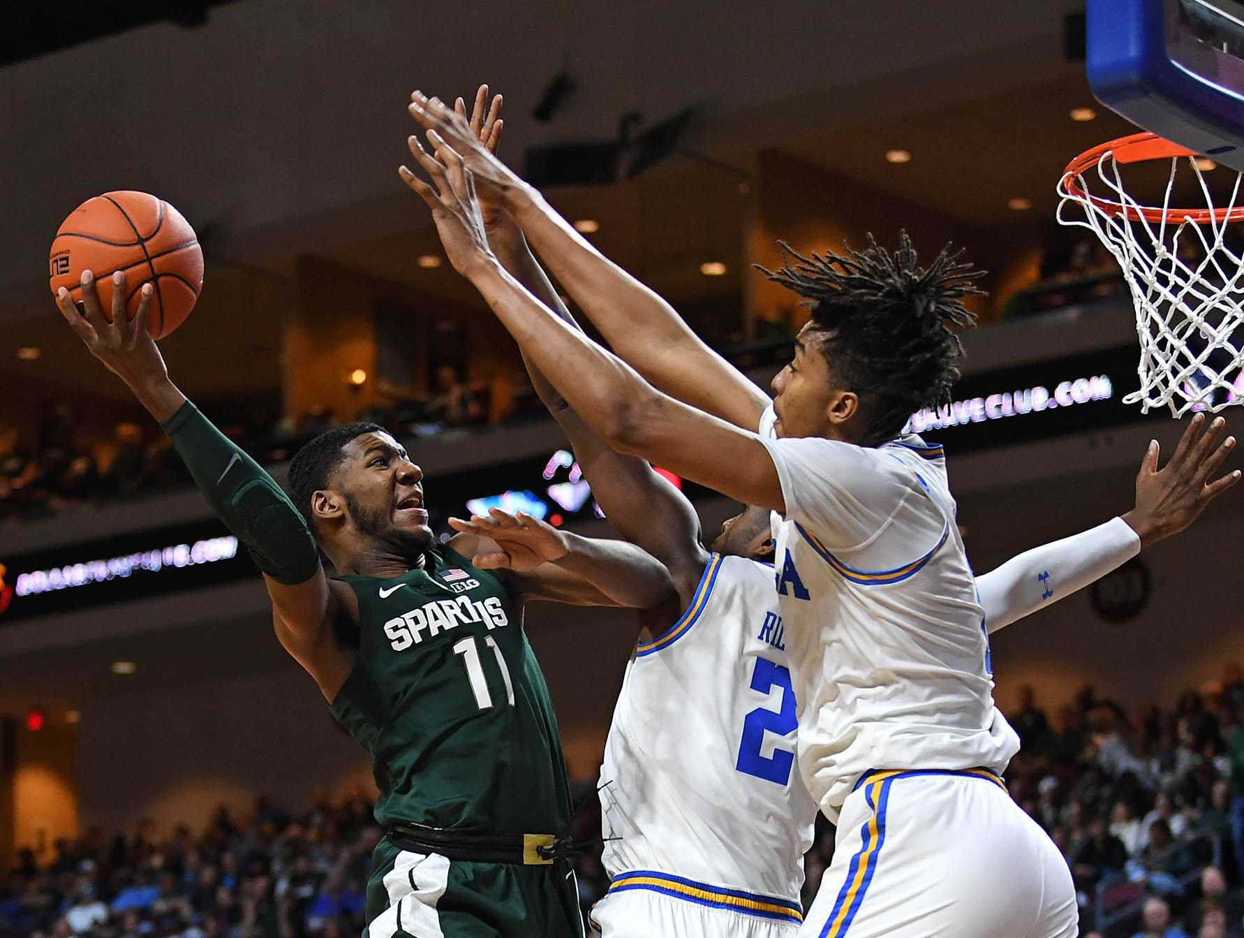 Nov 22, 2018; Las Vegas, NV, USA; Michigan State Spartans forward Aaron Henry (11) shoots during the first half against the UCLA Bruins at Orleans Arena. Mandatory Credit: Stephen R. Sylvanie-USA TODAY Sports