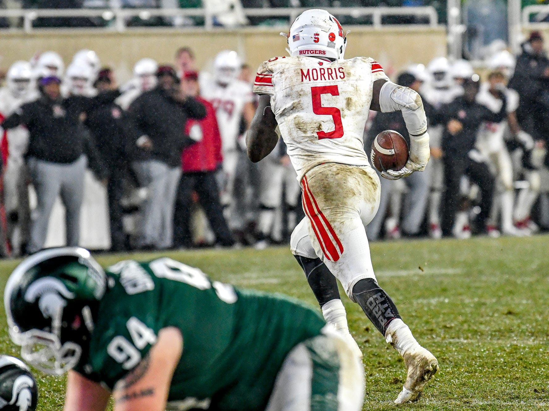Rutgers Trevor Morris runs with the ball after an interception on a Michigan State fake field goal attempt during the second quarter on Saturday, Nov. 24, 2018, at Spartan Stadium in East Lansing.