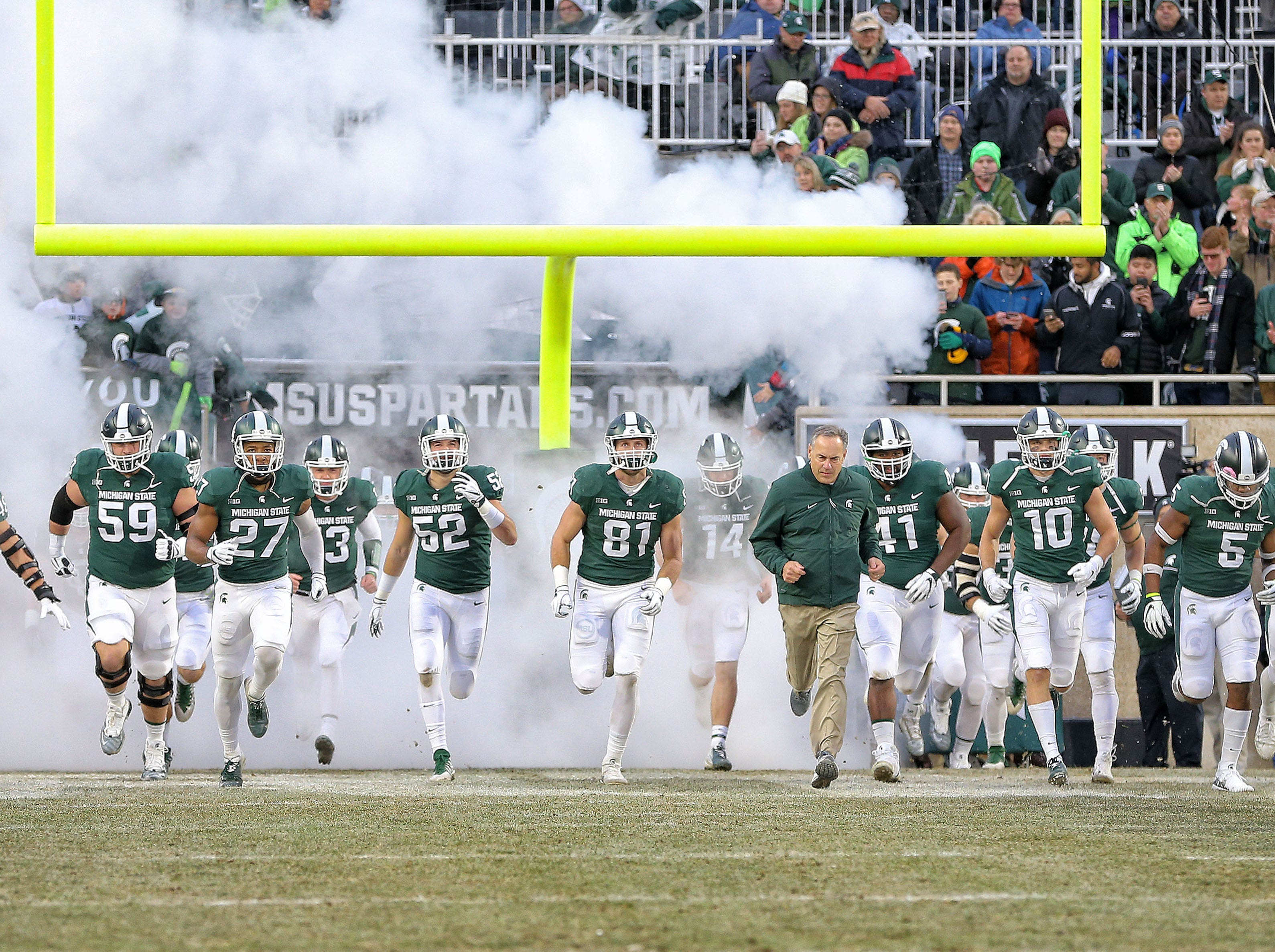 Nov 24, 2018; East Lansing, MI, USA; Michigan State Spartans run unto the field prior to  a game against the Rutgers Scarlet Knights at Spartan Stadium. Mandatory Credit: Mike Carter-USA TODAY Sports