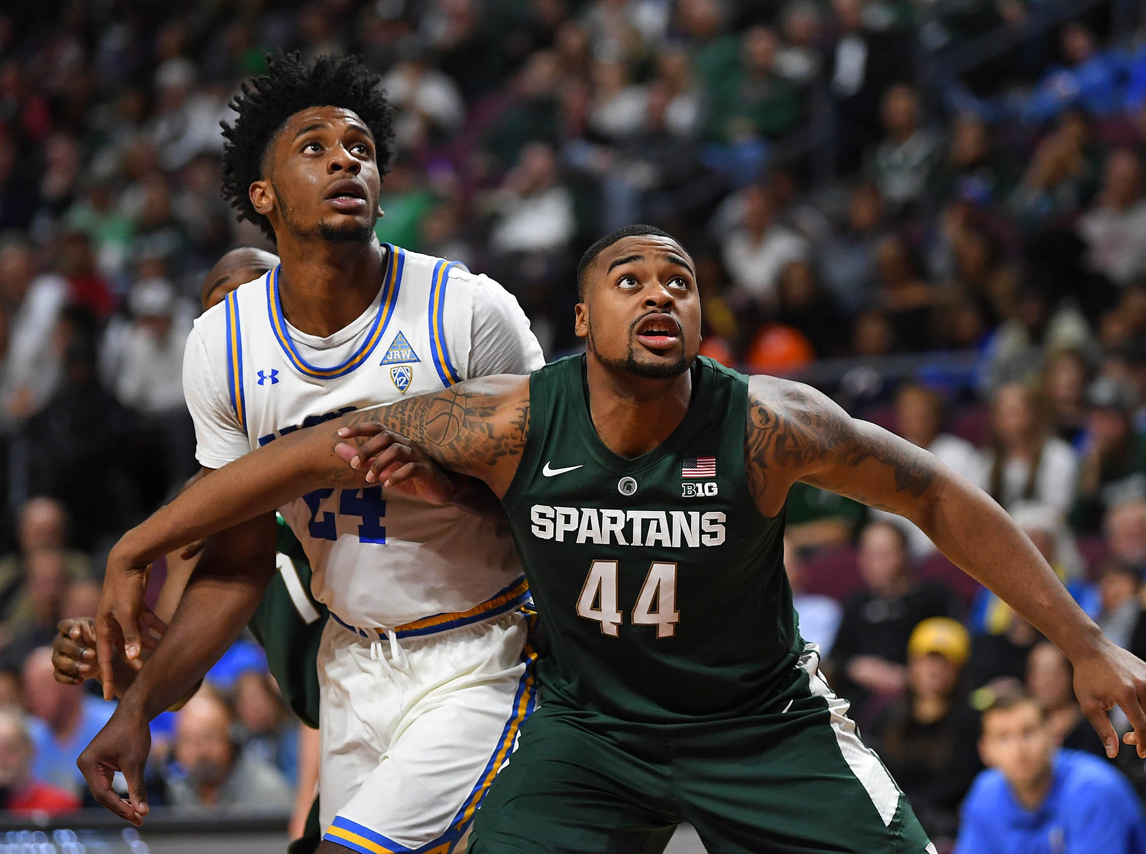 Nov 22, 2018; Las Vegas, NV, USA; Michigan State Spartans forward Nick Ward (44) blocks out UCLA Bruins guard Jalen Hill (24) during a second half free throw attempt at Orleans Arena. Mandatory Credit: Stephen R. Sylvanie-USA TODAY Sports