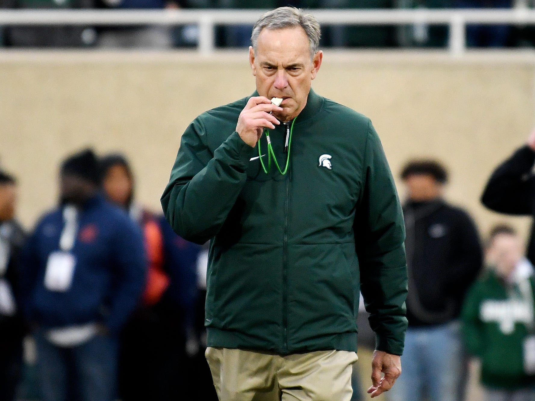 Michigan State head coach Mark Dantonio works with the team before the game against Rutgers on Saturday, Nov. 24, 2018, at Spartan Stadium in East Lansing.