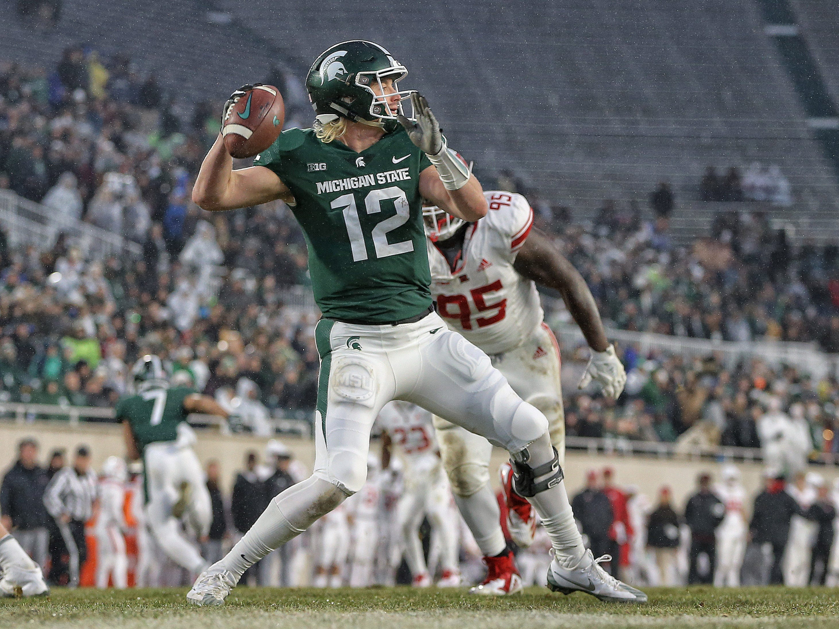 Nov 24, 2018; East Lansing, MI, USA; Michigan State Spartans quarterback Rocky Lombardi (12) drops back to throw a pass during the first half against the Rutgers Scarlet Knights at Spartan Stadium. Mandatory Credit: Mike Carter-USA TODAY Sports