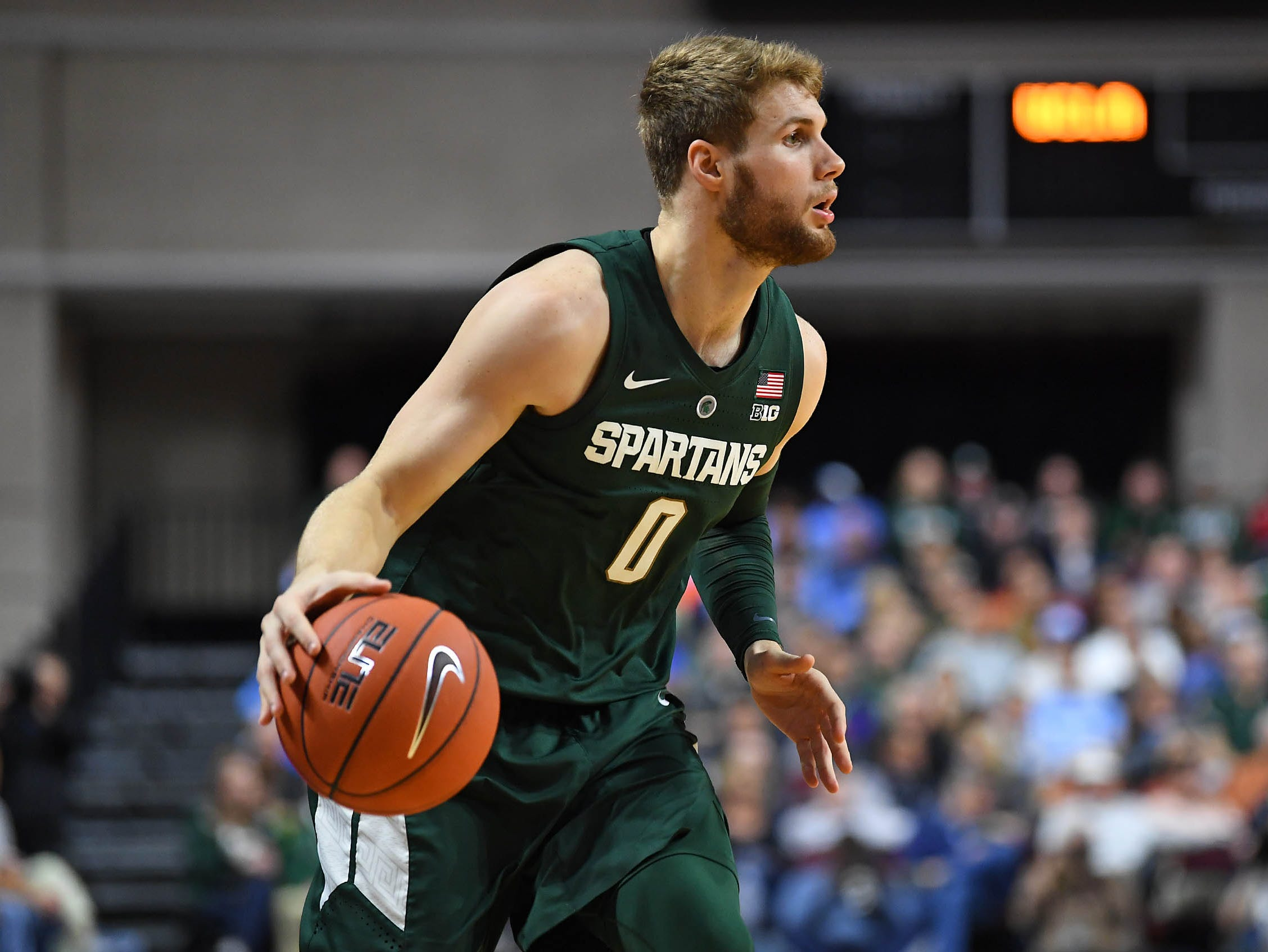 Michigan State Spartans forward Kyle Ahrens (0) dribbles during the first half against the UCLA Bruins at Orleans Arena.