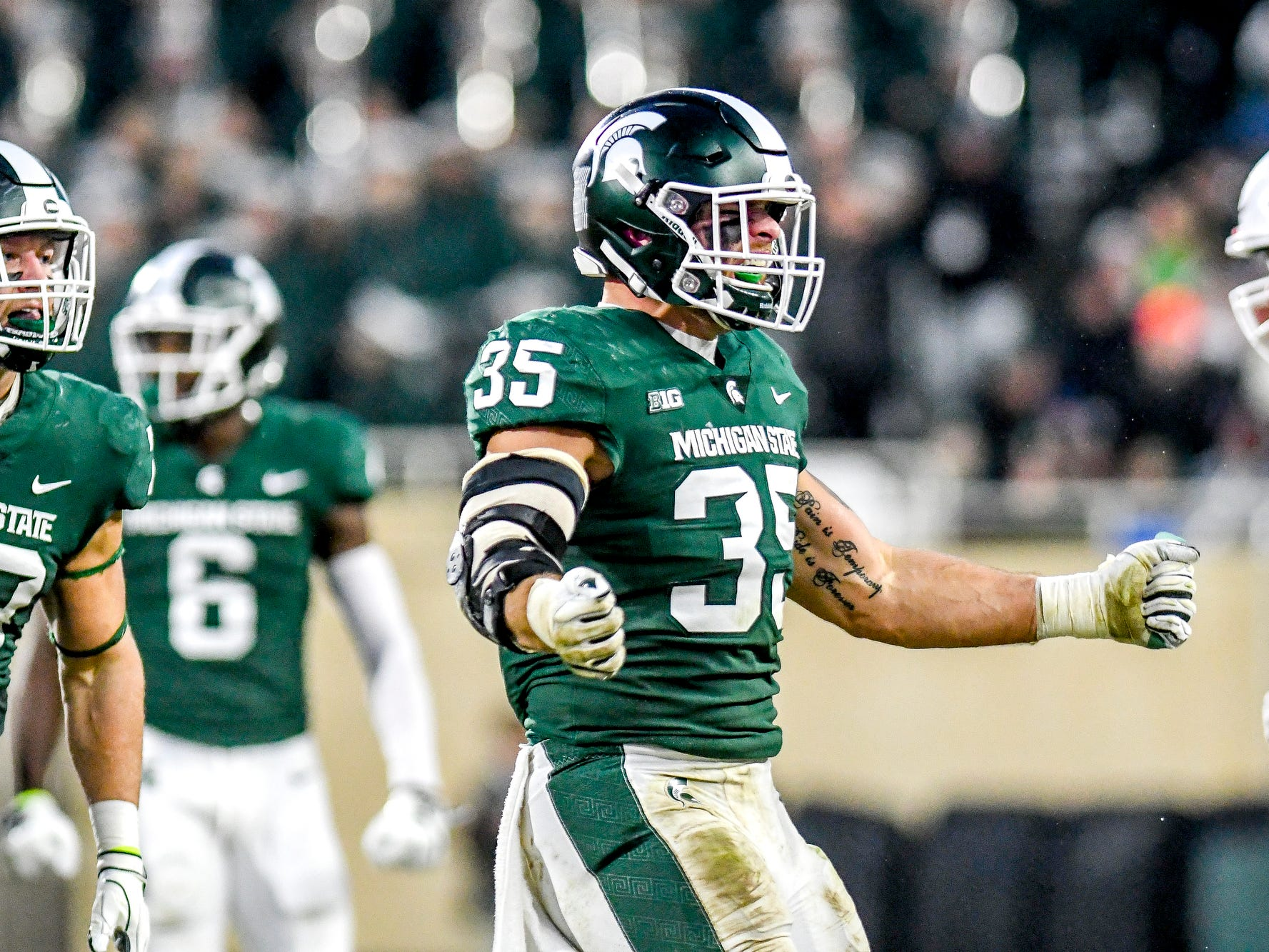 Michigan State's Joe Bachie celebrates after a tackle during the second quarter on Saturday, Nov. 24, 2018, at Spartan Stadium in East Lansing.