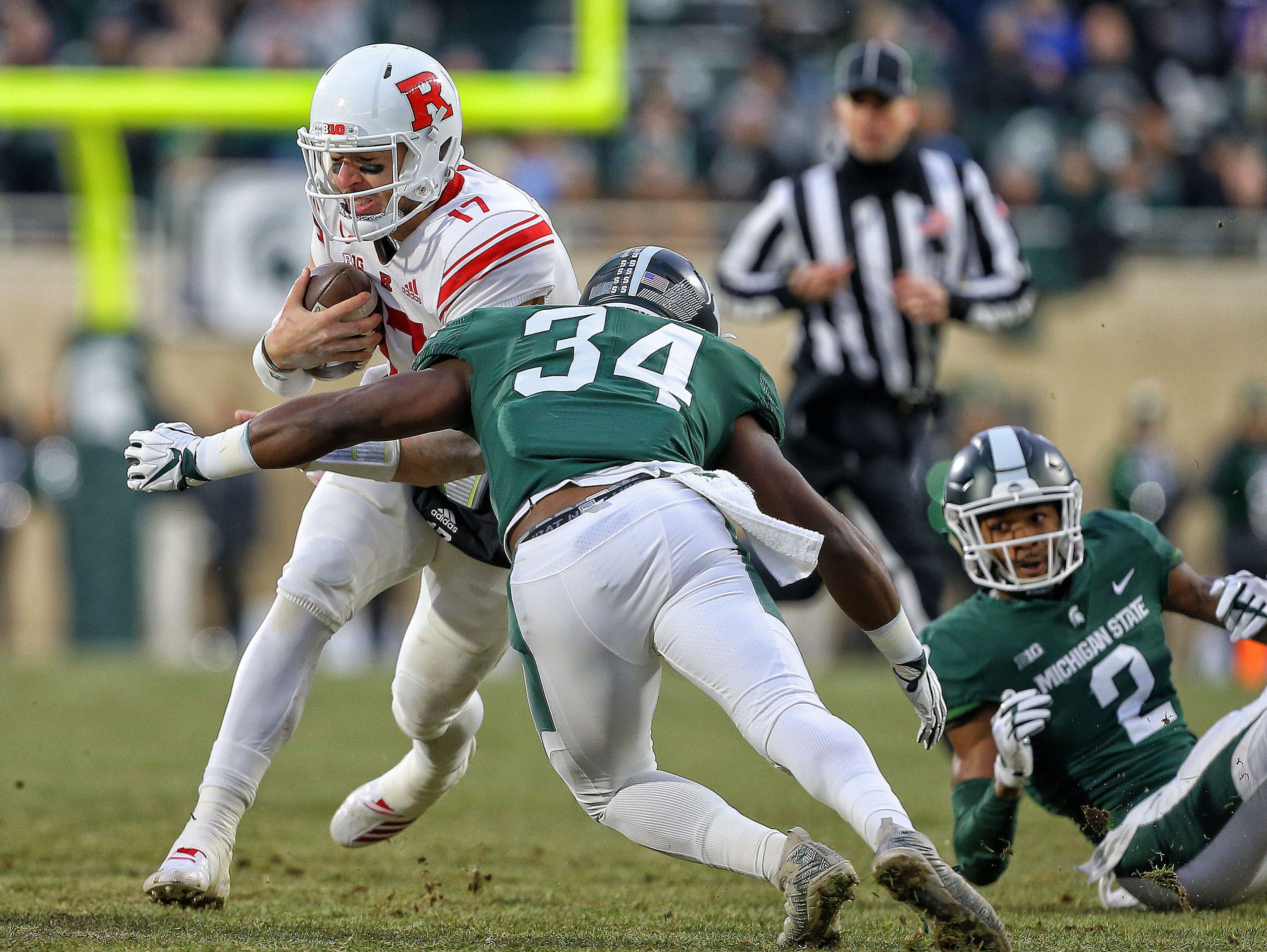 Nov 24, 2018; East Lansing, MI, USA; Rutgers Scarlet Knights quarterback Giovanni Rescigno (17) is tackled by Michigan State Spartans linebacker Antjuan Simmons (34) during the first quarter of a game at Spartan Stadium. Mandatory Credit: Mike Carter-USA TODAY Sports