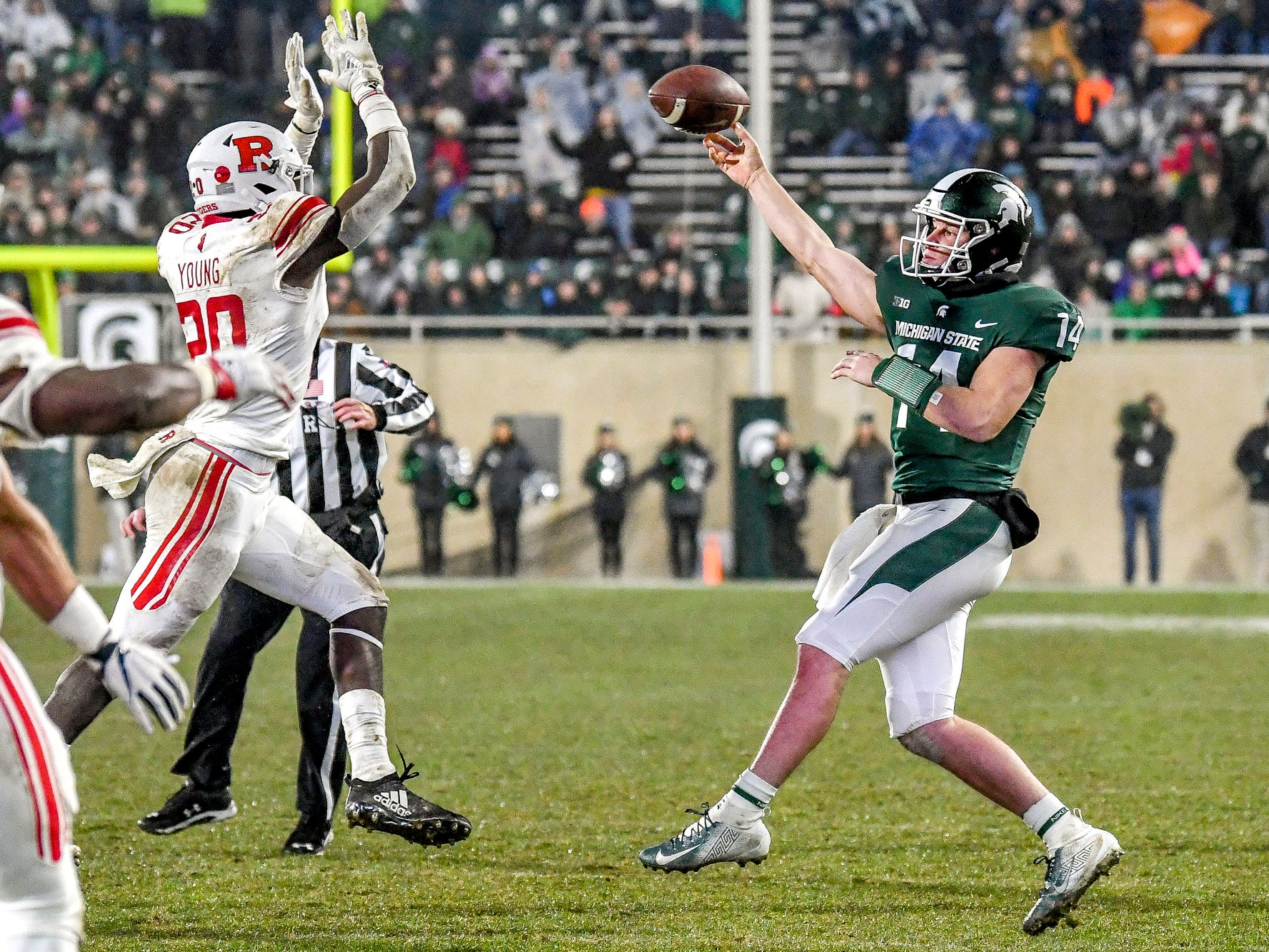 Michigan State's Brian Lewerke throws a pass on a fake field goal attempt during the second quarter on Saturday, Nov. 24, 2018, at Spartan Stadium in East Lansing. The pass was intercepted.