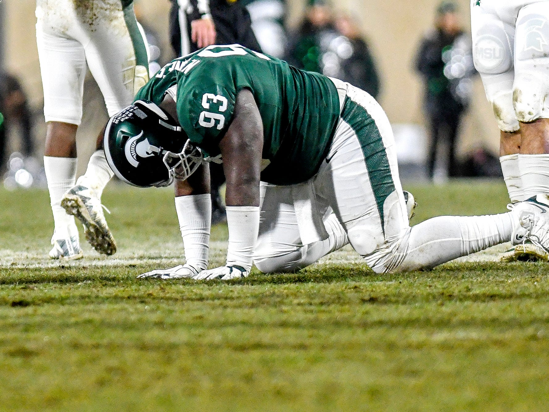 Michigan State's Naquan Jones is shaken up on a play during the second quarter on Saturday, Nov. 24, 2018, at Spartan Stadium in East Lansing.