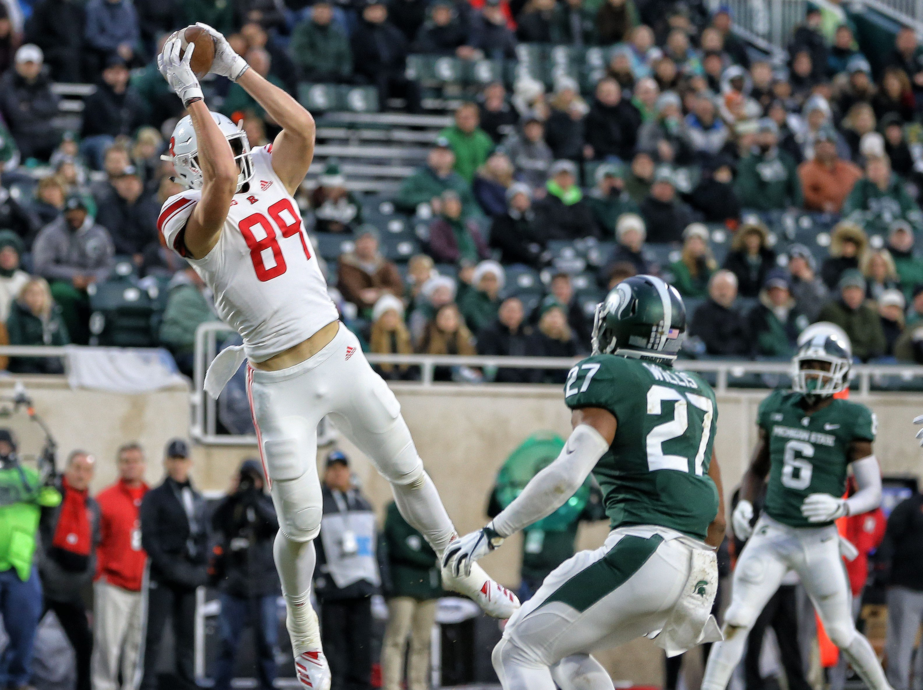 Nov 24, 2018; East Lansing, MI, USA; Rutgers Scarlet Knights tight end Travis Vokolek (89) makes a touchdown catch against the Michigan State Spartans during the first quarter of a game at Spartan Stadium. Mandatory Credit: Mike Carter-USA TODAY Sports