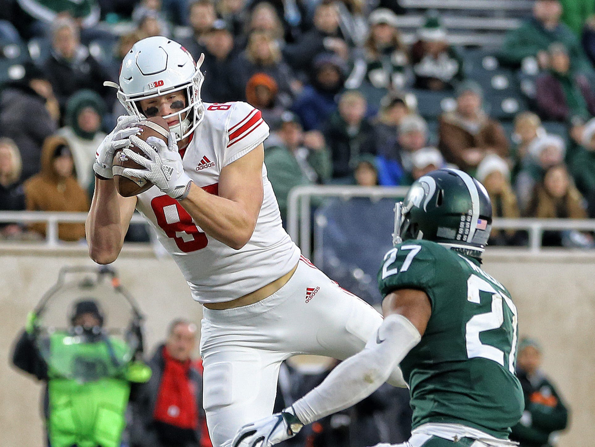 Nov 24, 2018; East Lansing, MI, USA; Rutgers Scarlet Knights tight end Travis Vokolek (89) makes a touchdown catch in front of Michigan State Spartans safety Khari Willis (27)  during the first quarter of a game at Spartan Stadium. Mandatory Credit: Mike Carter-USA TODAY Sports