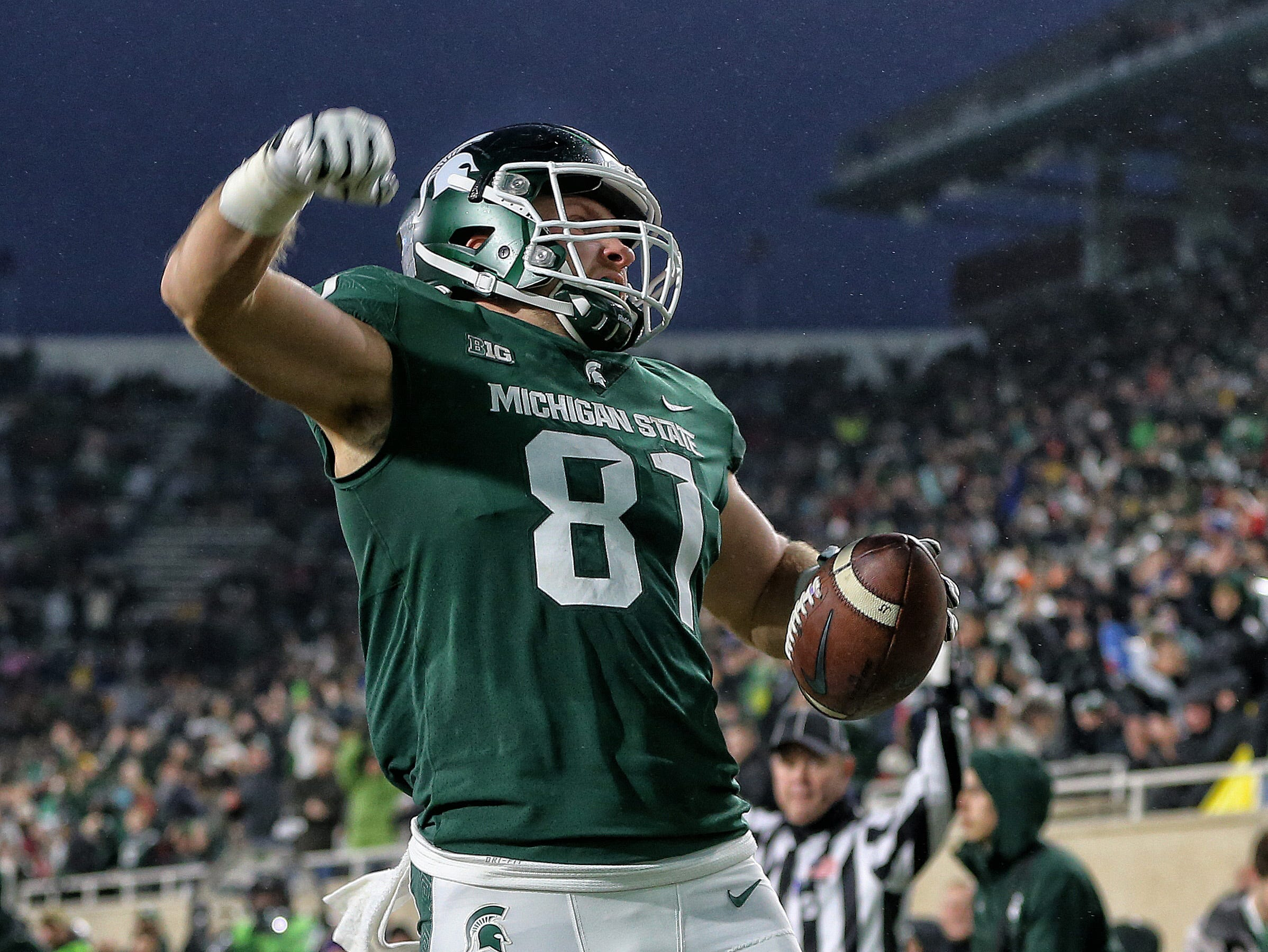 Nov 24, 2018; East Lansing, MI, USA; Michigan State Spartans tight end Matt Sokol (81) celebrates after a touchdown during the first half against the Rutgers Scarlet Knights at Spartan Stadium. Mandatory Credit: Mike Carter-USA TODAY Sports