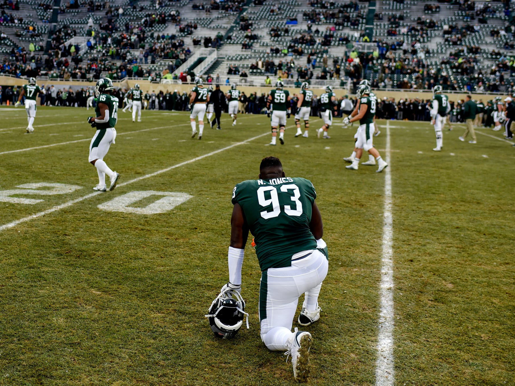 Michigan State's Naquan Jones takes a break during team warm-ups before the game against Rutgers on Saturday, Nov. 24, 2018, at Spartan Stadium in East Lansing.