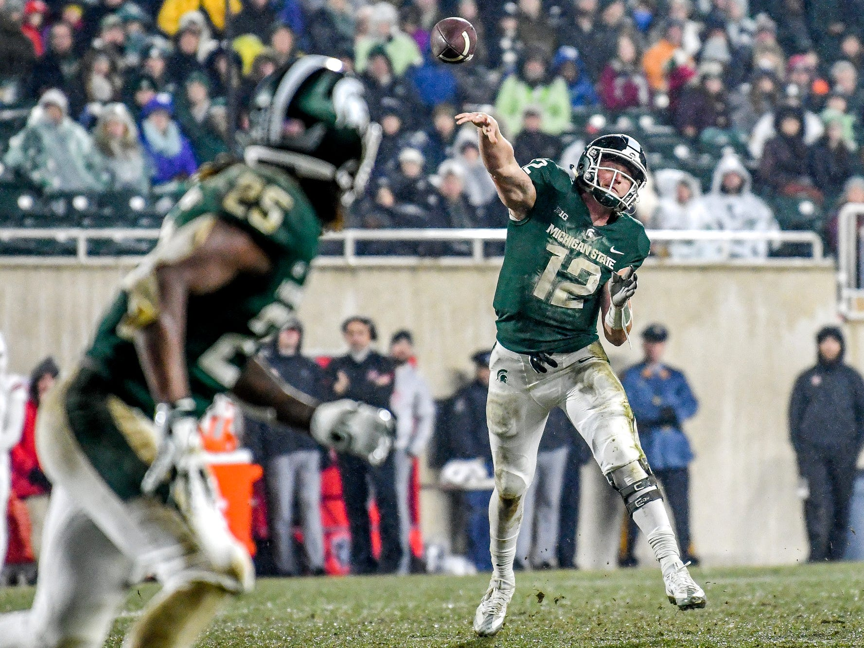Michigan State's quarterback Rocky Lombardi, right, throws a pass to Darrell Stewart Jr. in the end zone during the second quarter on Saturday, Nov. 24, 2018, at Spartan Stadium in East Lansing. The pass was incomplete.