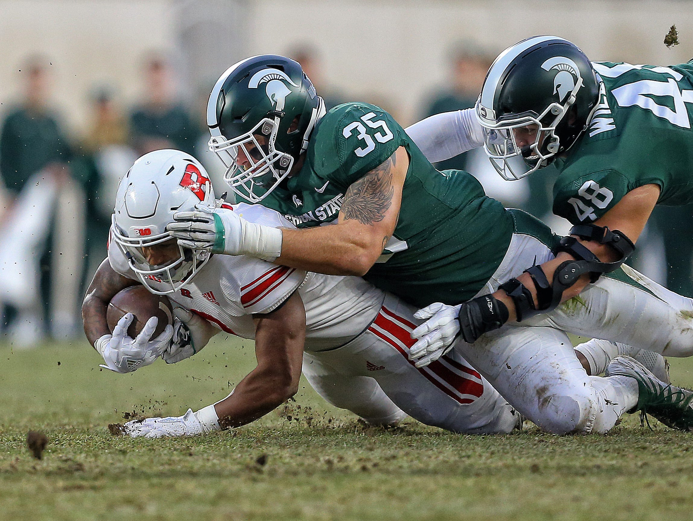 Nov 24, 2018; East Lansing, MI, USA; Rutgers Scarlet Knights running back Raheem Blackshear (2) is tackled by Michigan State Spartans linebacker Joe Bachie (35) during the first quarter of a game at Spartan Stadium. Mandatory Credit: Mike Carter-USA TODAY Sports