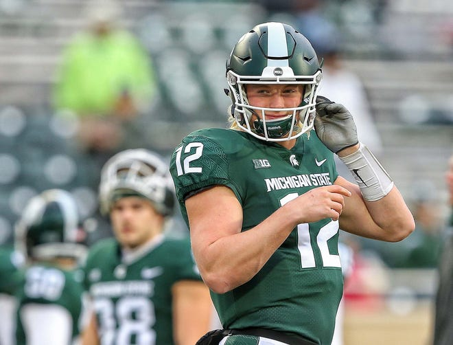 Nov 24, 2018; East Lansing, MI, USA; Michigan State Spartans quarterback Rocky Lombardi (12) warms up prior to  a game against the Rutgers Scarlet Knights at Spartan Stadium. Mandatory Credit: Mike Carter-USA TODAY Sports