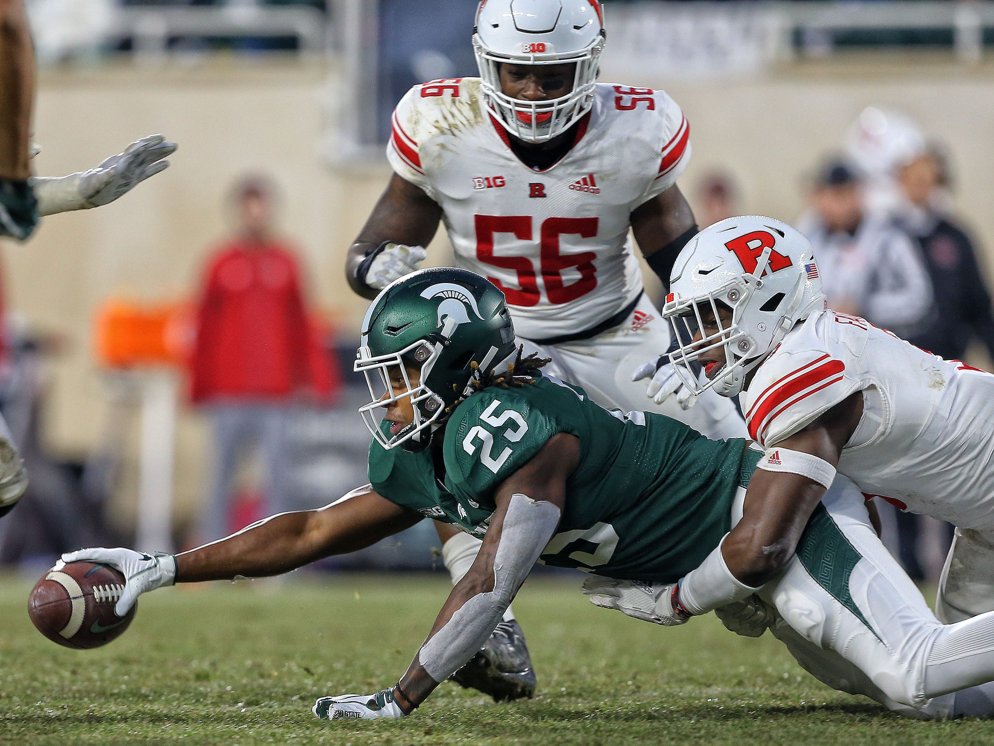 Nov 24, 2018; East Lansing, MI, USA; Michigan State Spartans wide receiver Darrell Stewart Jr. (25) reaches for extra yards during the first half against the Rutgers Scarlet Knights at Spartan Stadium. Mandatory Credit: Mike Carter-USA TODAY Sports