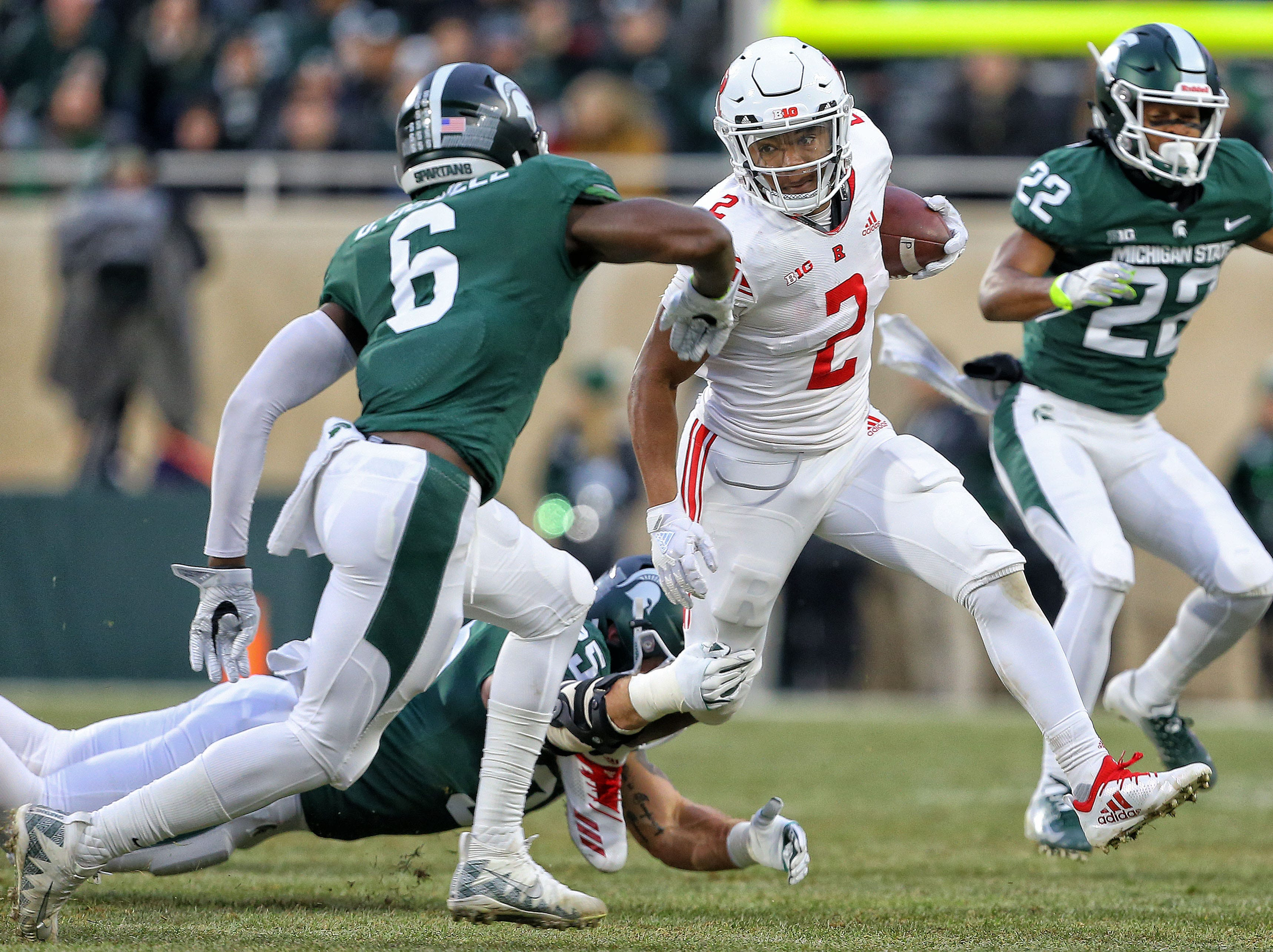 Nov 24, 2018; East Lansing, MI, USA; Rutgers Scarlet Knights running back Raheem Blackshear (2) runs the ball in front of Michigan State Spartans safety David Dowell (6) during the first quarter of a game at Spartan Stadium. Mandatory Credit: Mike Carter-USA TODAY Sports