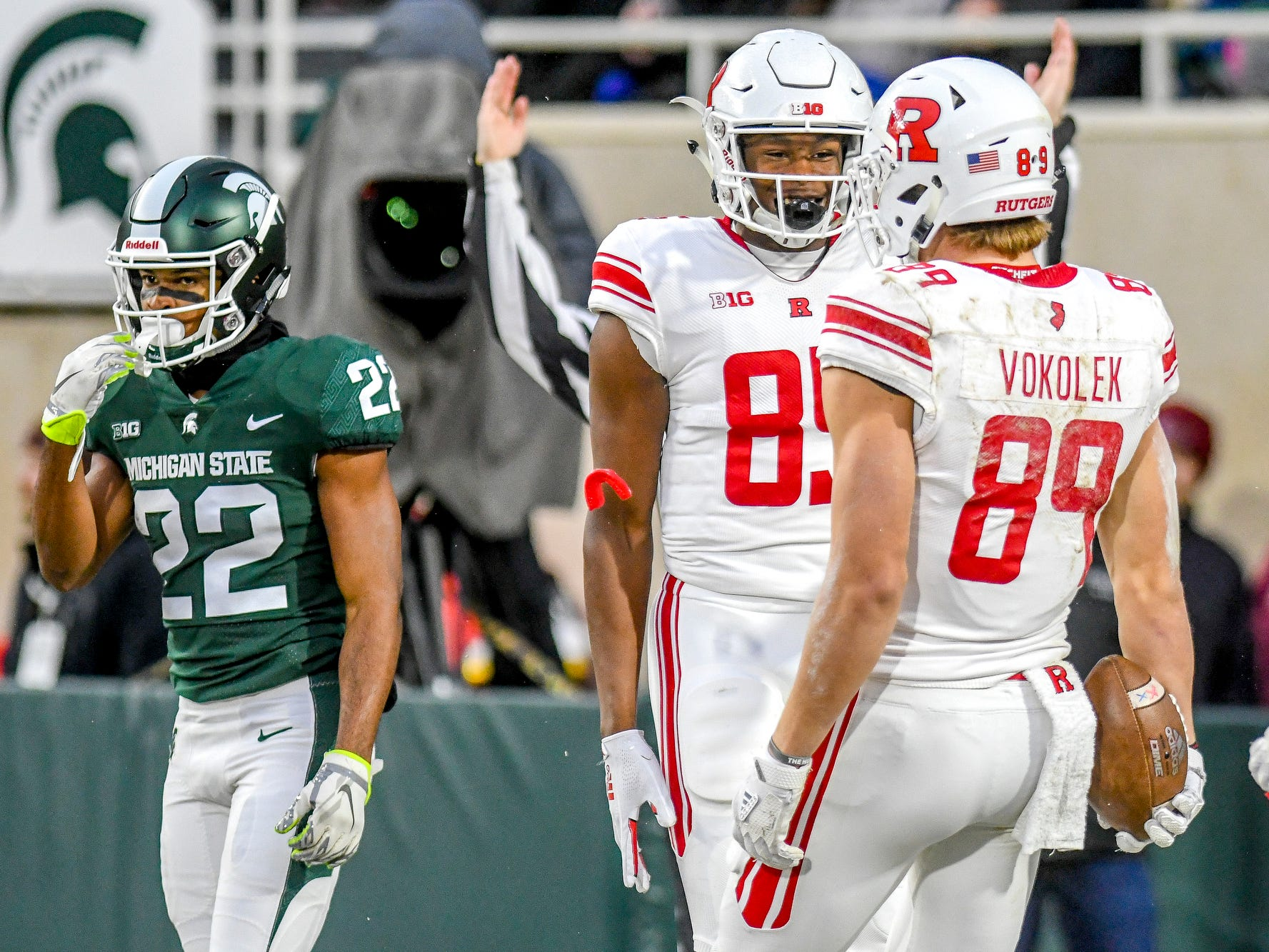 Michigan State's Josiah Scott, left, looks on as Rutgers Travis Vokolek, right, celebrates his touchdown catch with teammate Daevon Robinson during the first quarter on Saturday, Nov. 24, 2018, at Spartan Stadium in East Lansing.