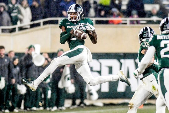 Michigan State's Justin Layne nearly intercepts a Rutgers pass during the second quarter on Saturday, Nov. 24, 2018, at Spartan Stadium in East Lansing.