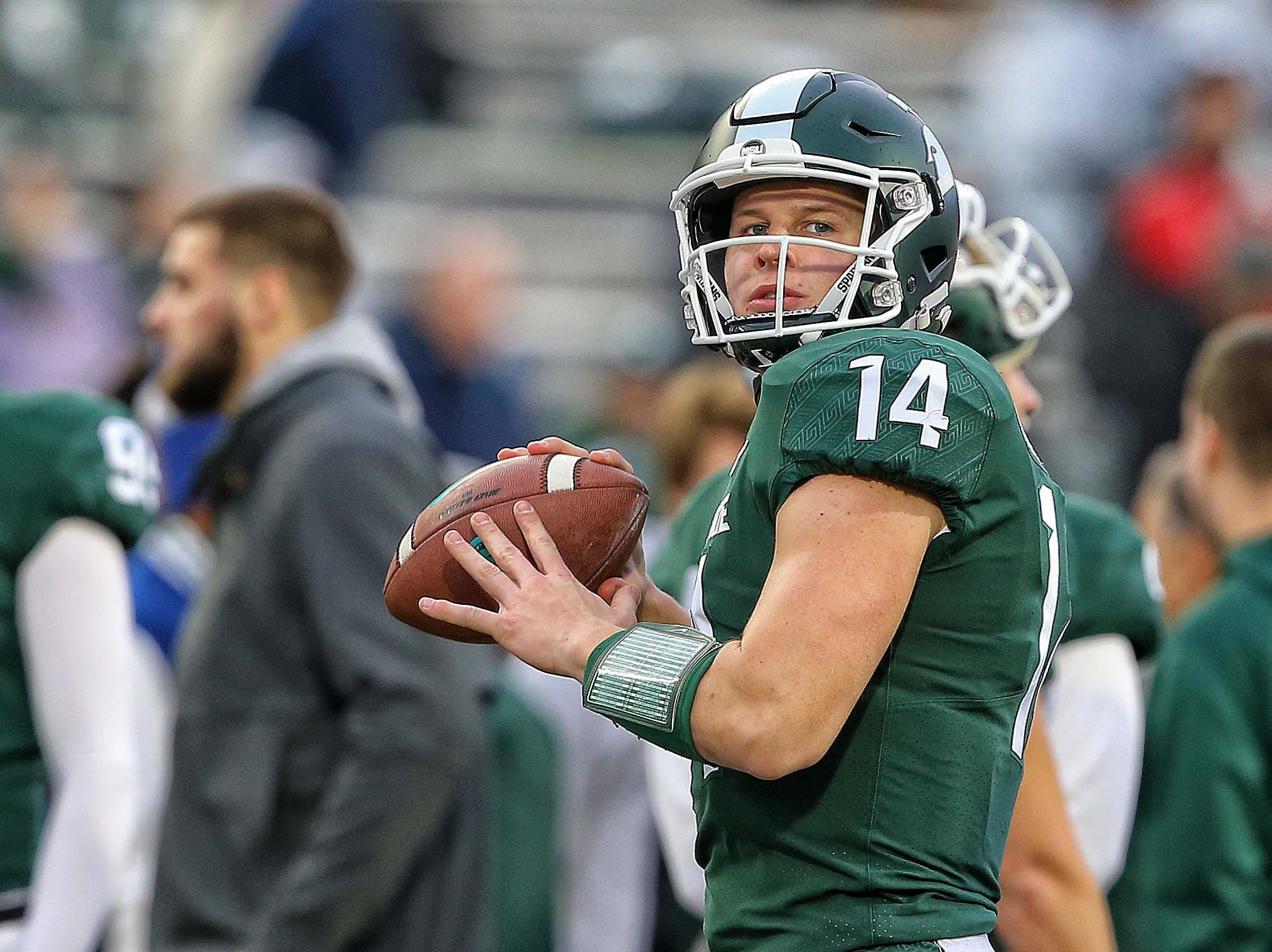 Nov 24, 2018; East Lansing, MI, USA; Michigan State Spartans quarterback Brian Lewerke (14) warms up prior to  a game against the Rutgers Scarlet Knights at Spartan Stadium. Mandatory Credit: Mike Carter-USA TODAY Sports