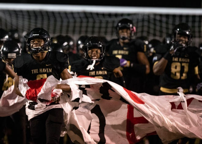 Whitehaven players run onto the field before their game Friday.