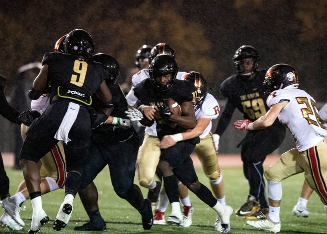 Whitehaven Tigers halfback Cameron Sneed (11) carries the ball across the field against Ravenwood Raptors during a high school football game, Friday, Nov. 23, 2018.