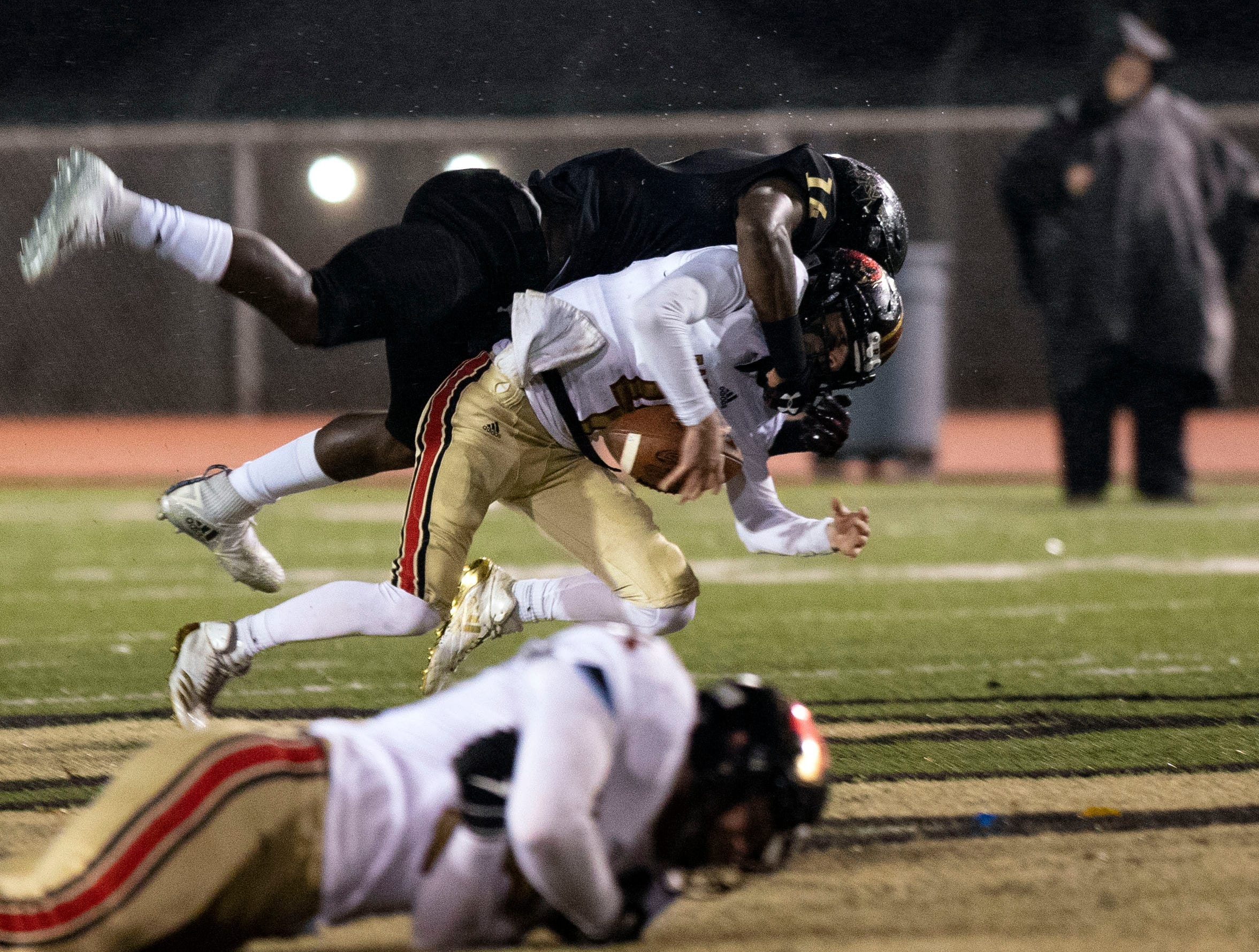 Ravenwood Raptors quarterback Brian Garcia (4) is sacked by Whitehaven Tigers wide receiver Keveon Mullins (14)  during the first half of high school football game, Friday, Nov. 23, 2018.