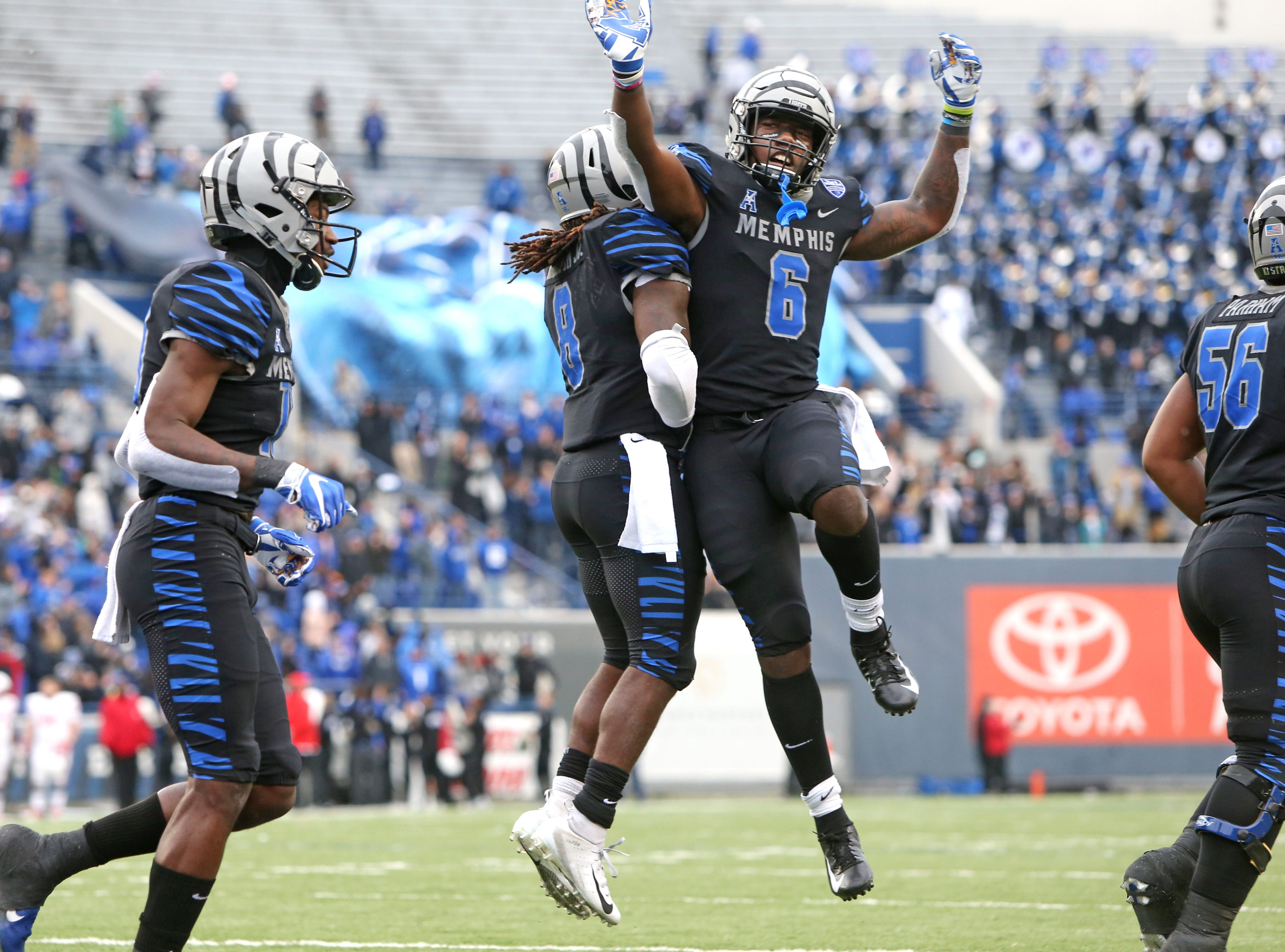 Memphis players Darrell Henderson (8) and Patrick Taylor Jr. (6) celebrate Henderson's touchdown against the Houston Cougars as they win the AAC West title 52-31 at the Liberty Bowl on Friday, Nov. 23, 2018.