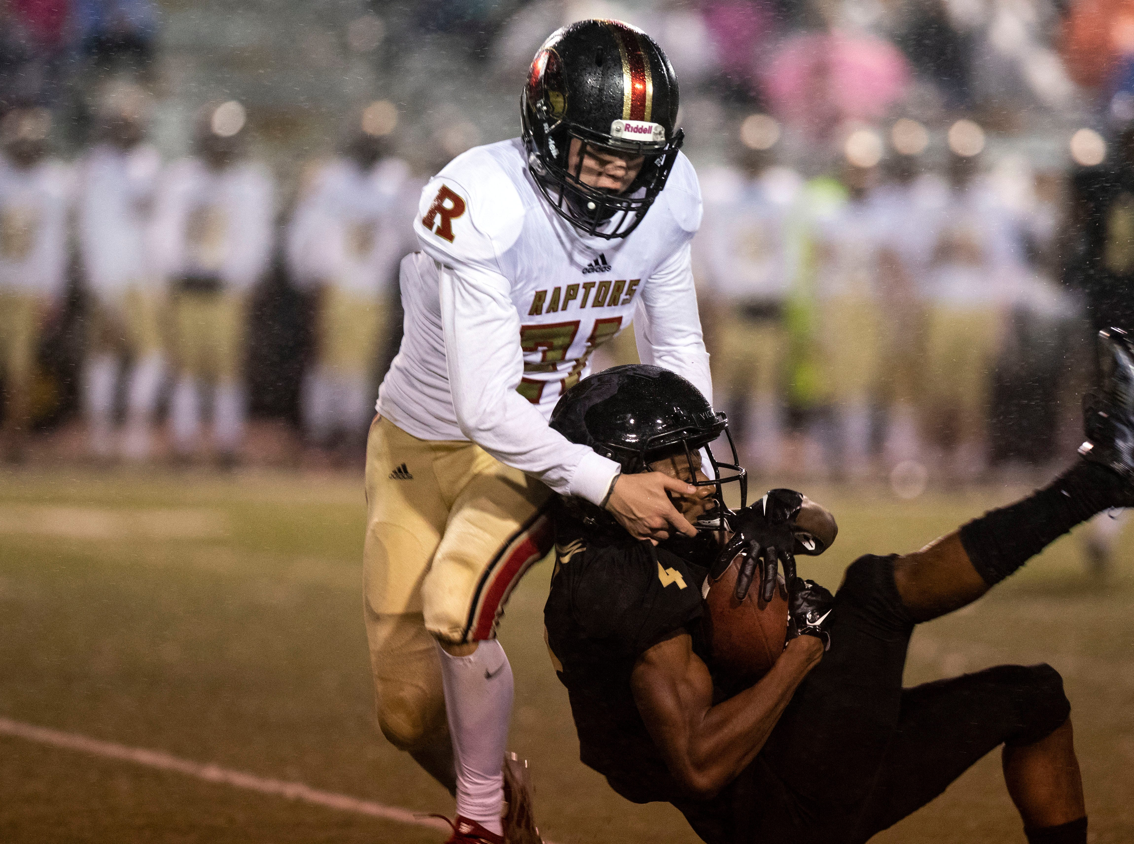 Whitehaven Tigers wide receiver Devin Boddie jr. (4) is tackled by Ravenwood Raptors cornerback Garrett Moorman (31) during the first half of a playoff football game in Memphis Tenn.