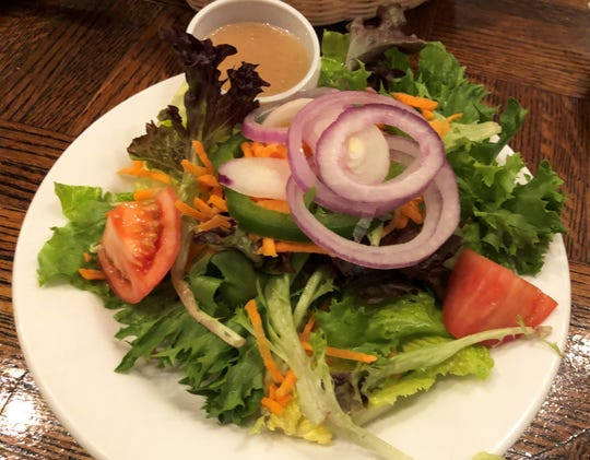 The house salad that comes with your entree at Kretch's, Marco Island.