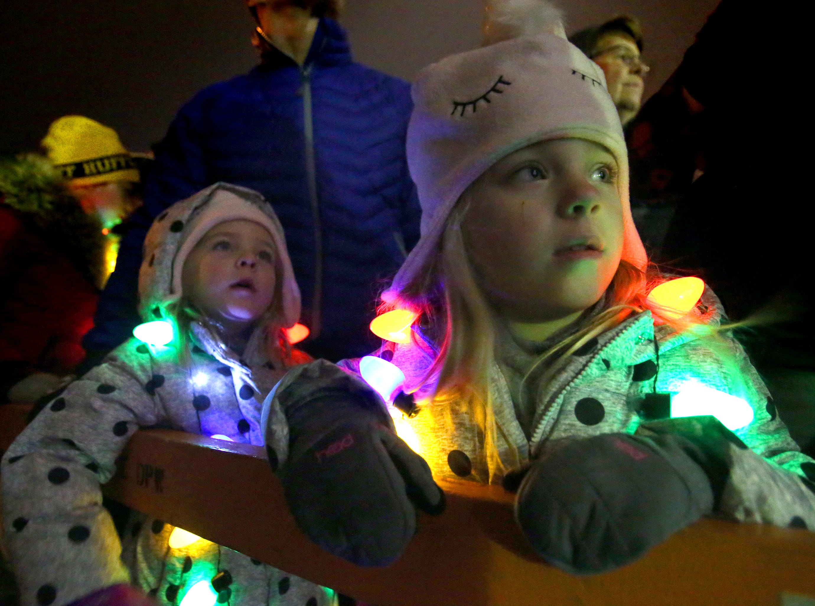 Maddie (right) and Charlie Steffenhagen wait for thousands of lights to illuminate and for Santa to arrive as part of Greendale's annual Tree Lighting in front of Village Hall on Nov. 23.