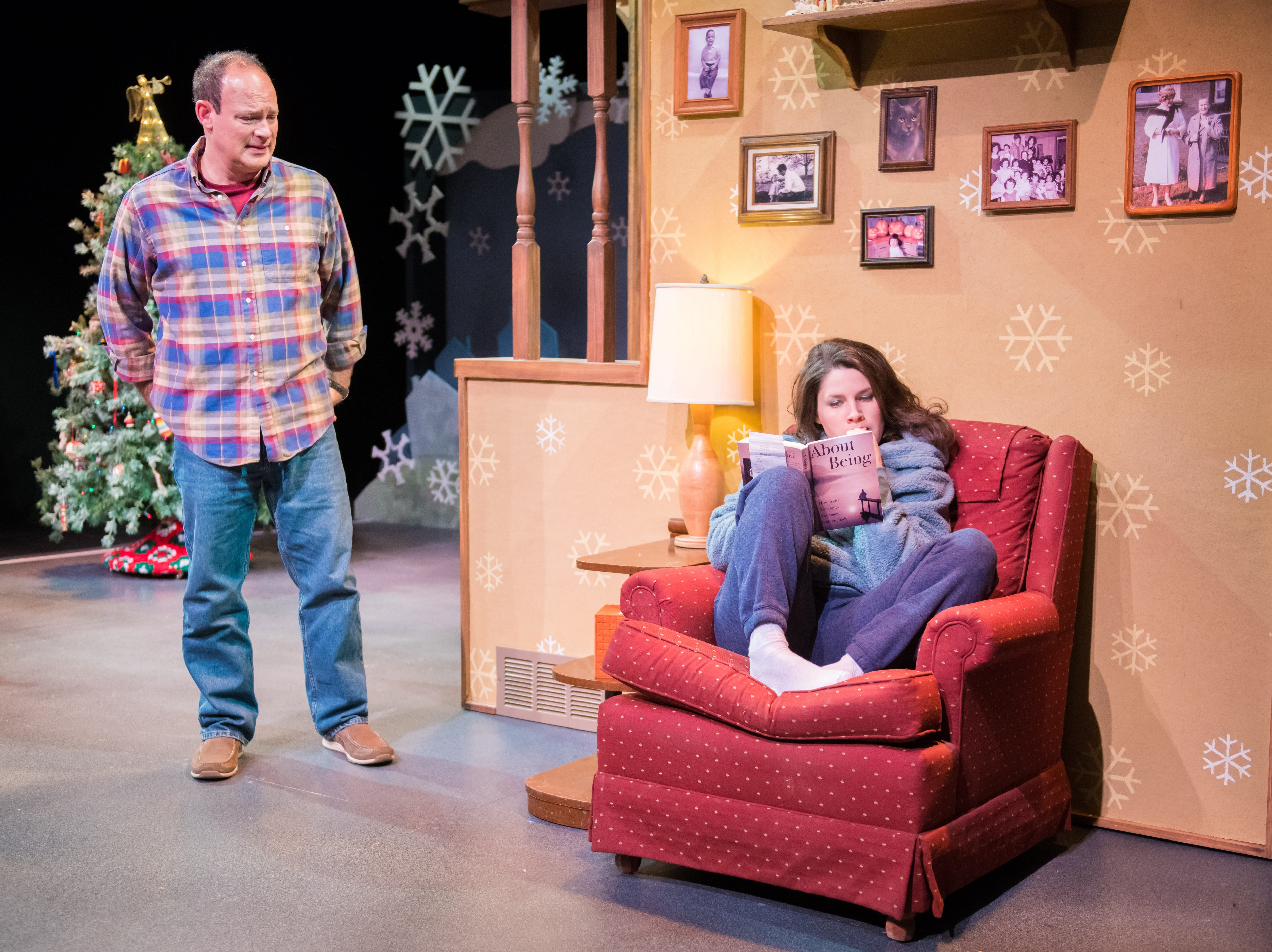 """Tom Klubertanz approaches Sara Zientek in """"Christmas in Babylon,"""" performed by Milwaukee Chamber Theatre."""