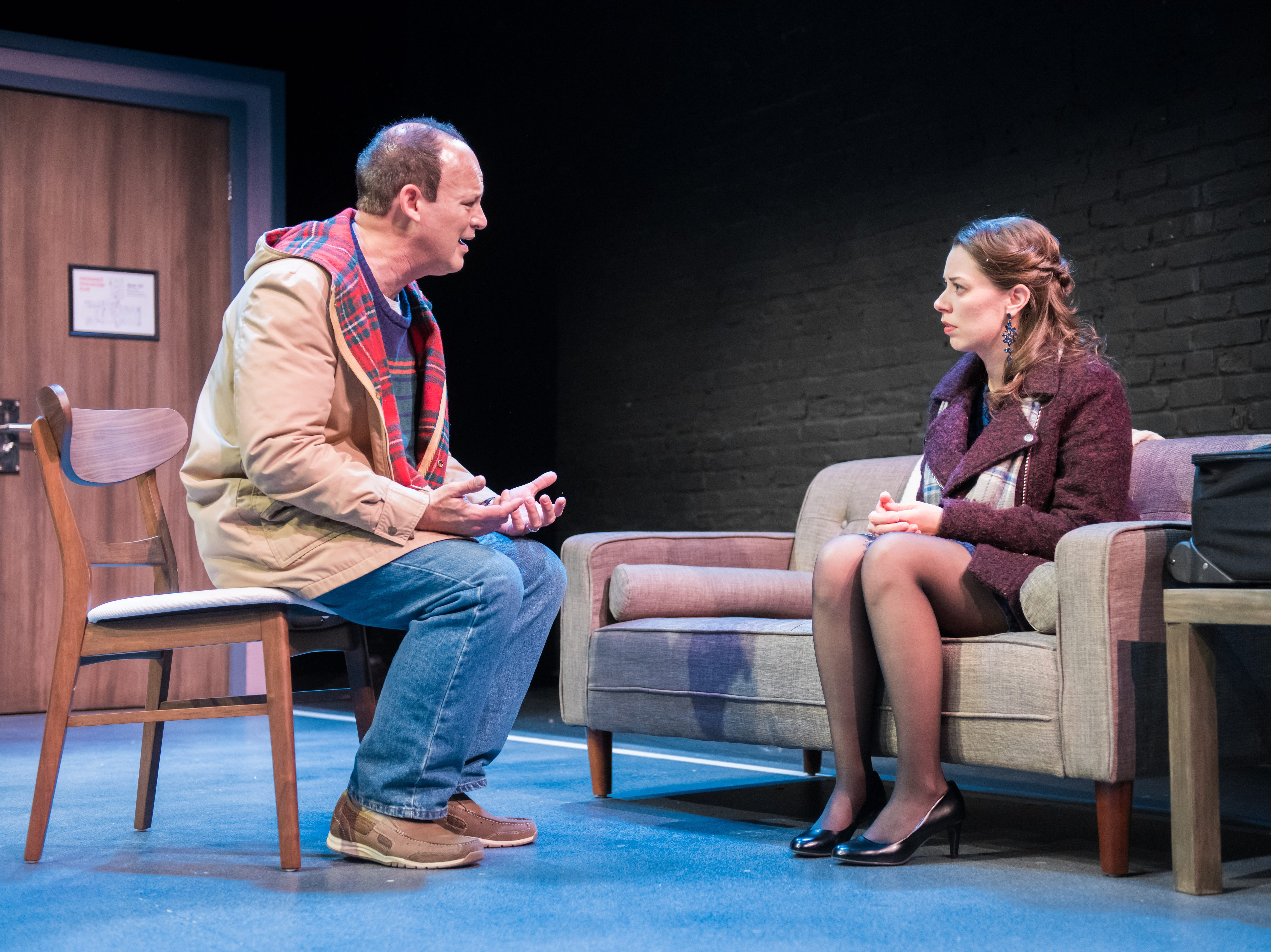 """Tom Klubertanz talks with Eva Nimmer in  """"Christmas in Babylon,"""" written by James DeVita and performed by Milwaukee Chamber Theatre."""