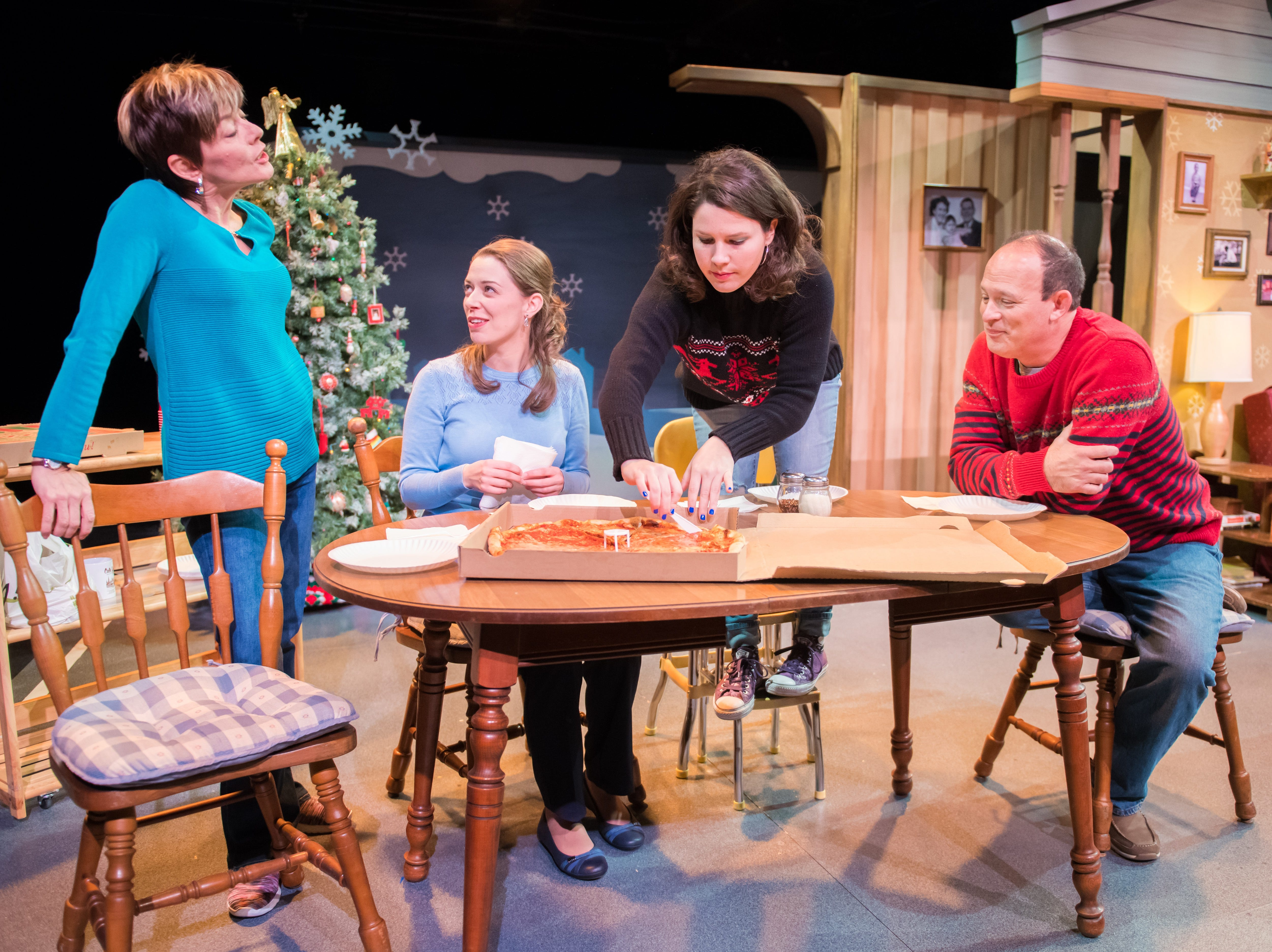 "Mary MacDonald Kerr (from left), Eva Nimmer, Sara Zientek and Tom Klubertanz gather around the table in ""Christmas in Babylon,"" written by James DeVita and performed by Milwaukee Chamber Theatre."