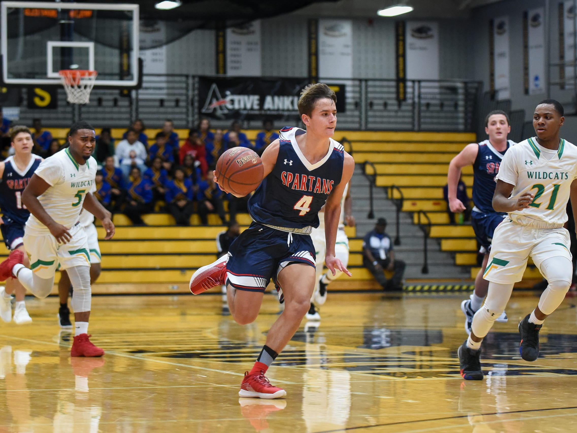 Brookfield East sophomore guard Hayden Doyle brings the ball up court against Milwaukee Hamilton in the Fresh Coast Classic high school basketball showcase Saturday, November 24, 2018, at UW-Milwaukee's Klotsche Center.